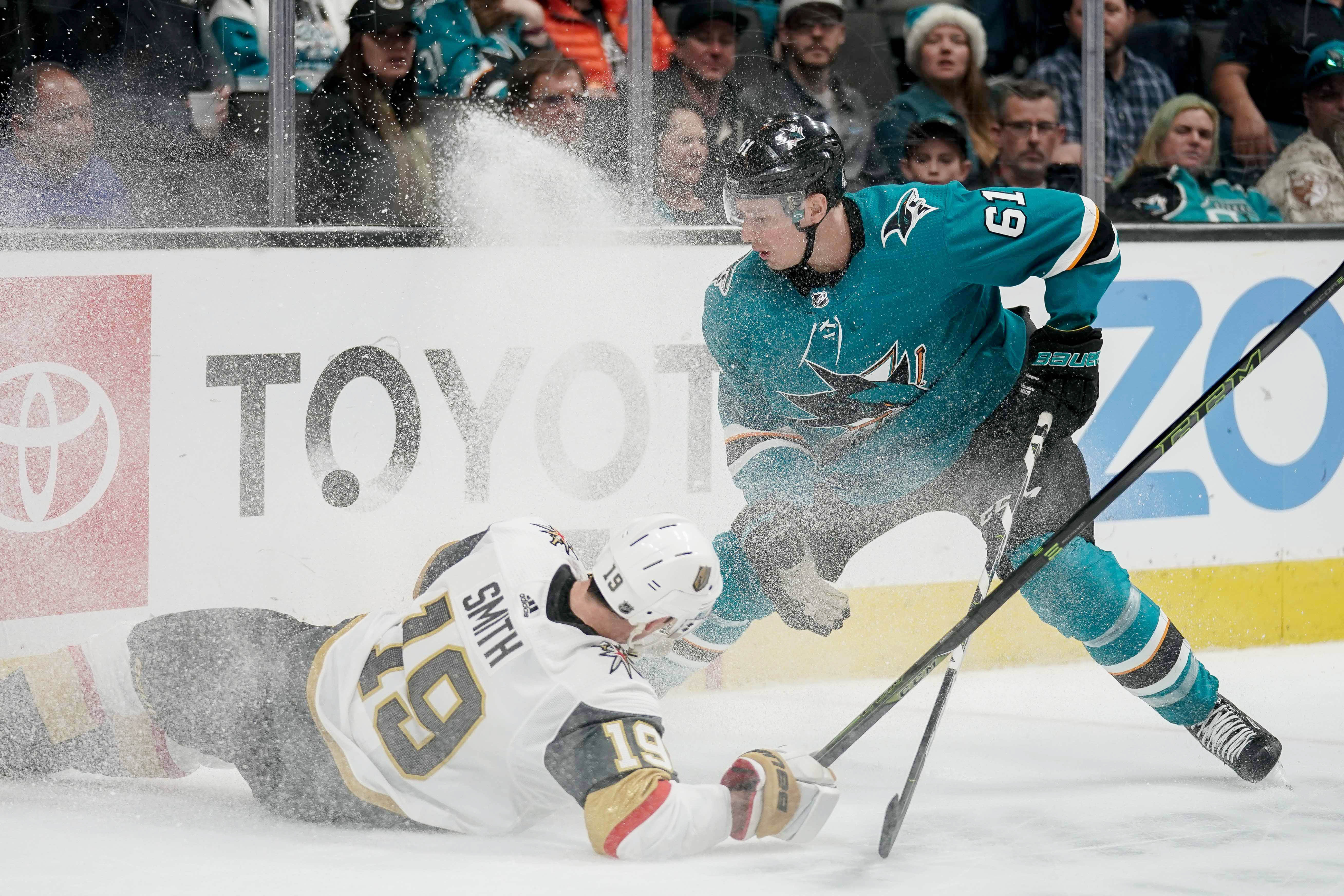 Mar 30, 2019; San Jose, CA, USA; Vegas Golden Knights right wing Reilly Smith (19) slips as San Jose Sharks defenseman Justin Braun (61) gains control of the puck during the second period at SAP Center at San Jose.