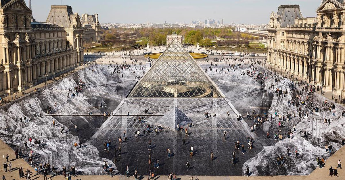 Louvre pyramid surrounded by paper