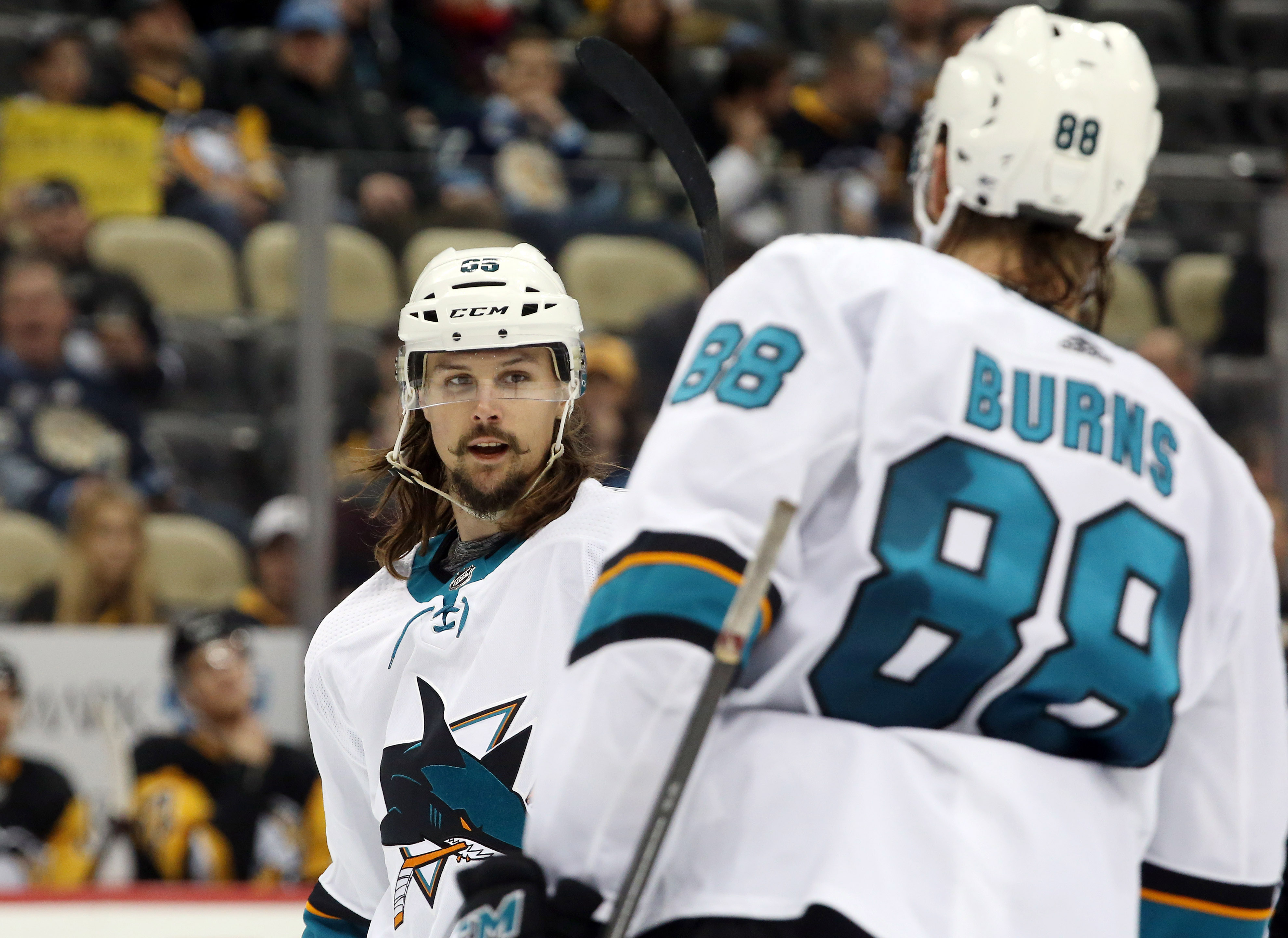 San Jose Sharks defenseman Erik Karlsson (65) reacts to a goal by defenseman Brent Burns (88) against the Pittsburgh Penguins during the third period at PPG PAINTS Arena. San Jose shutout the Penguins 4-0.