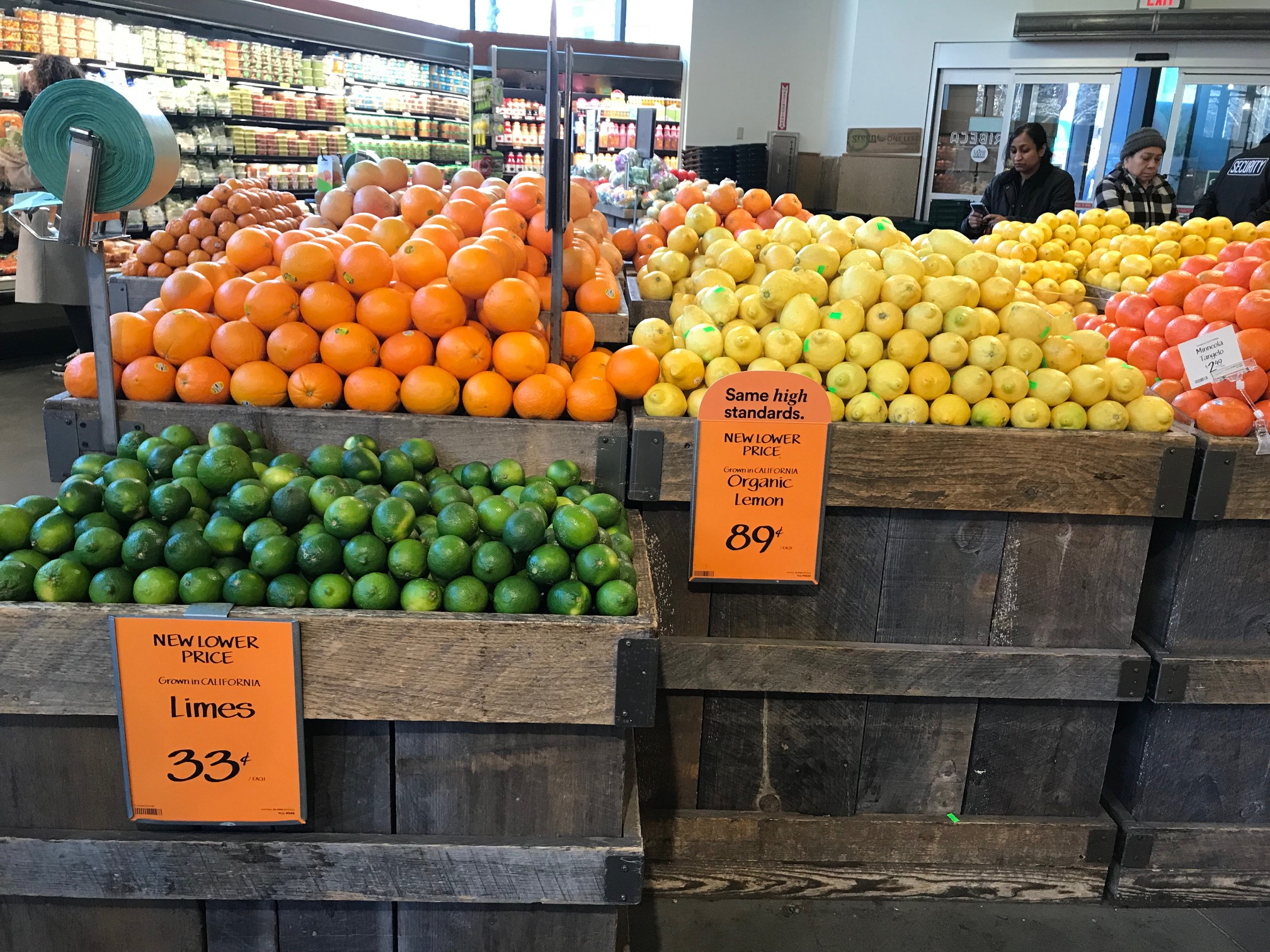 Oranges, lemons and limes are on display with discount price tags inside a Whole Foods in New York City.
