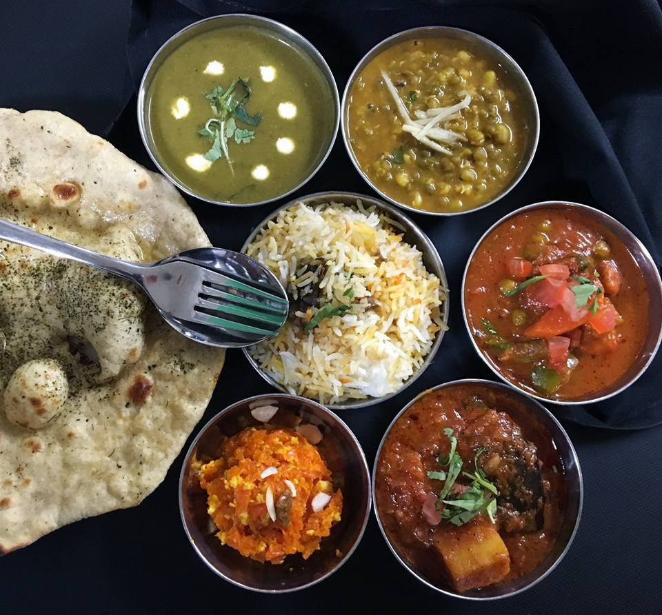 A selection of thalis at Nirmal's in Pioneer Square, with a side of naan.