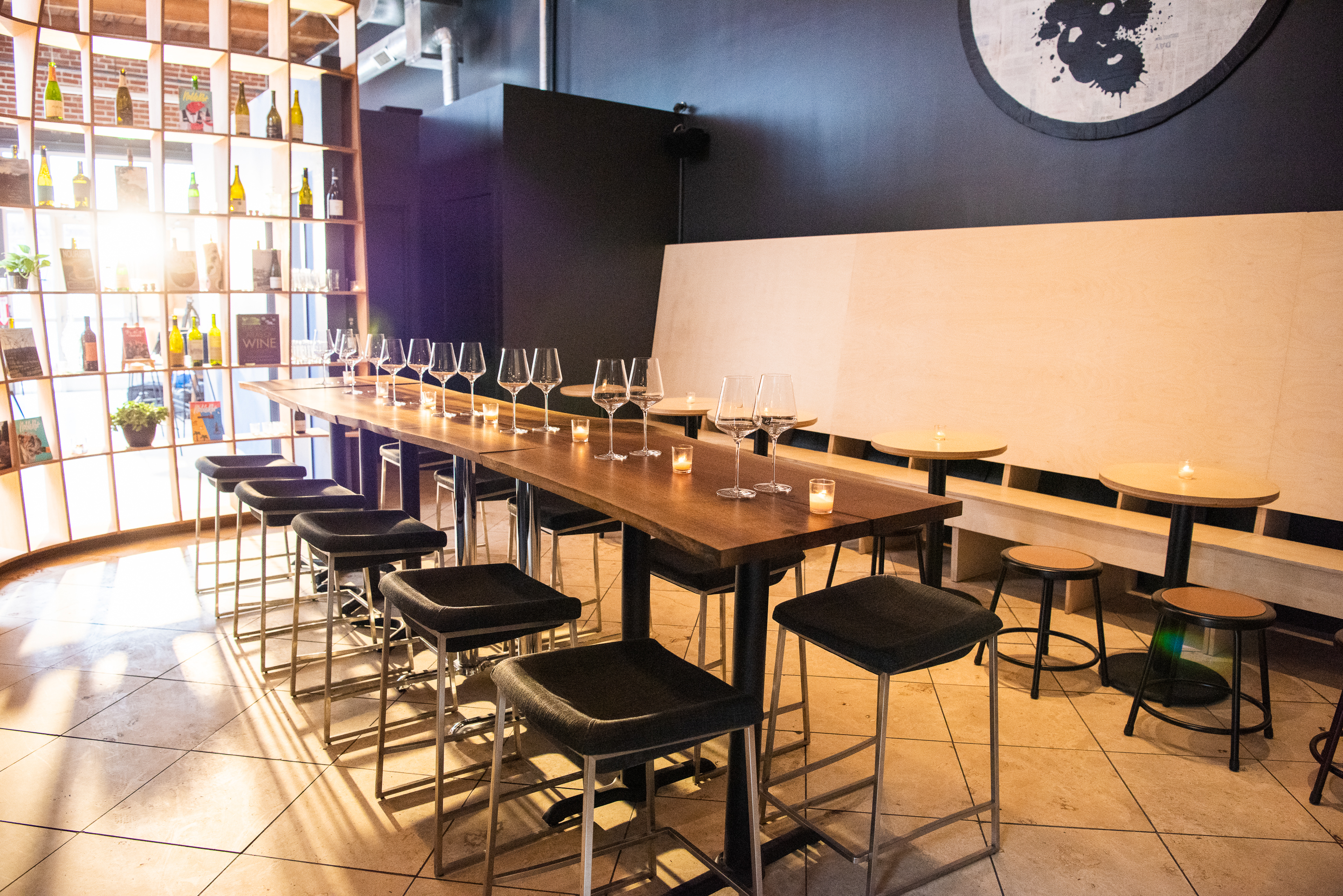 Wine bar with communal table and curved shelving