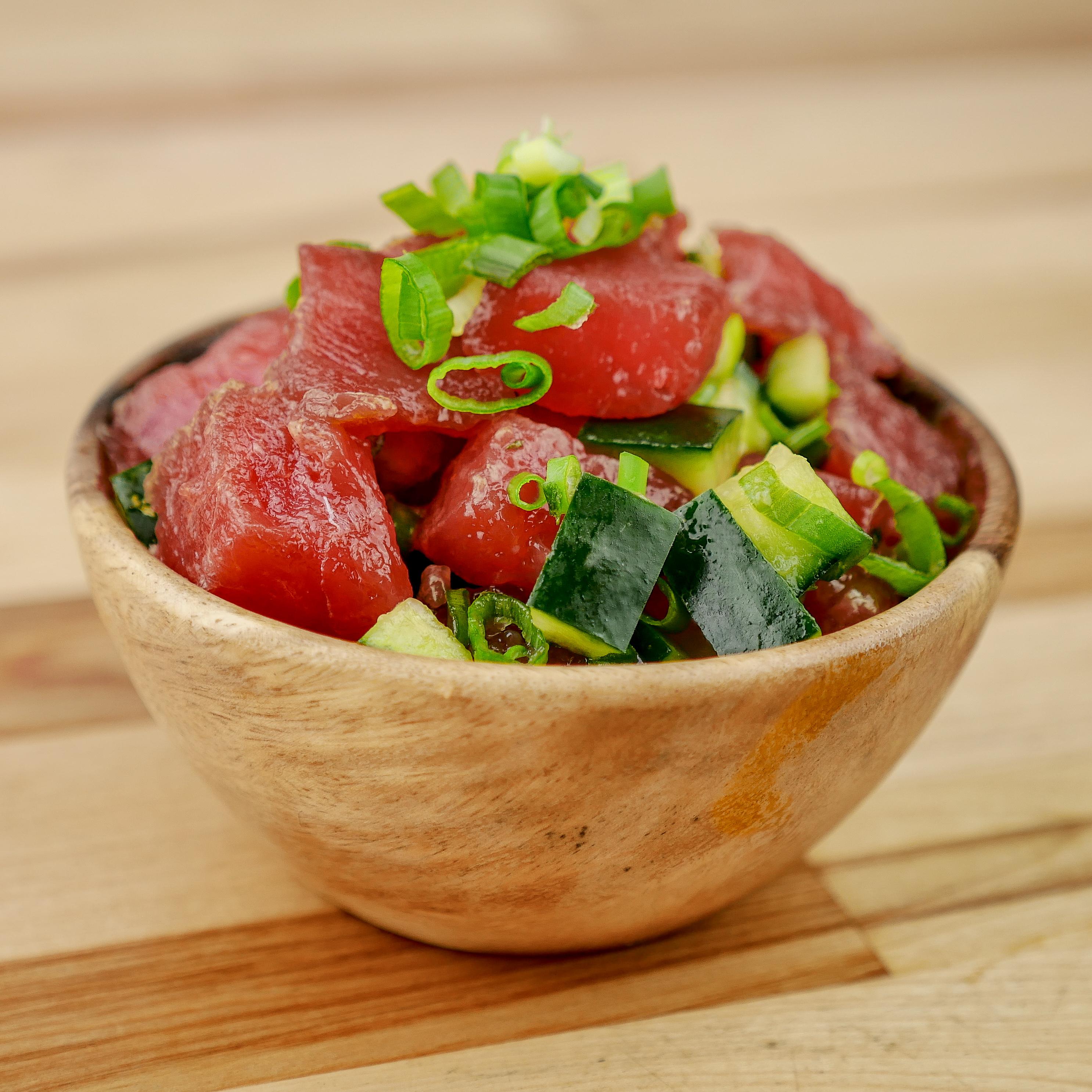 A small wooden bowl of shoyu tuna poke from Love Art Poke