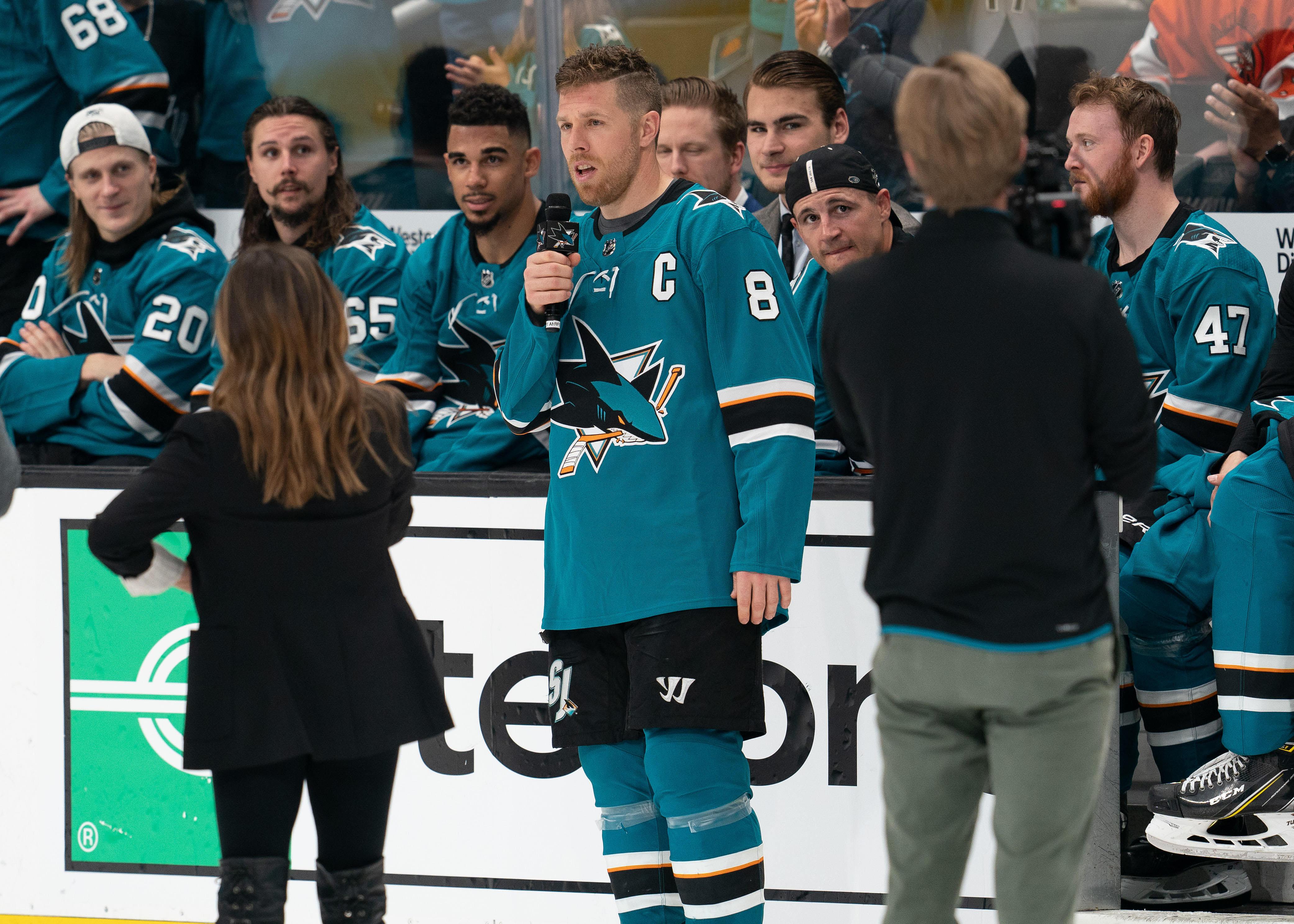 San Jose Sharks center Joe Pavelski (8) addresses fans after a game against the Colorado Avalanche at SAP Center at San Jose.