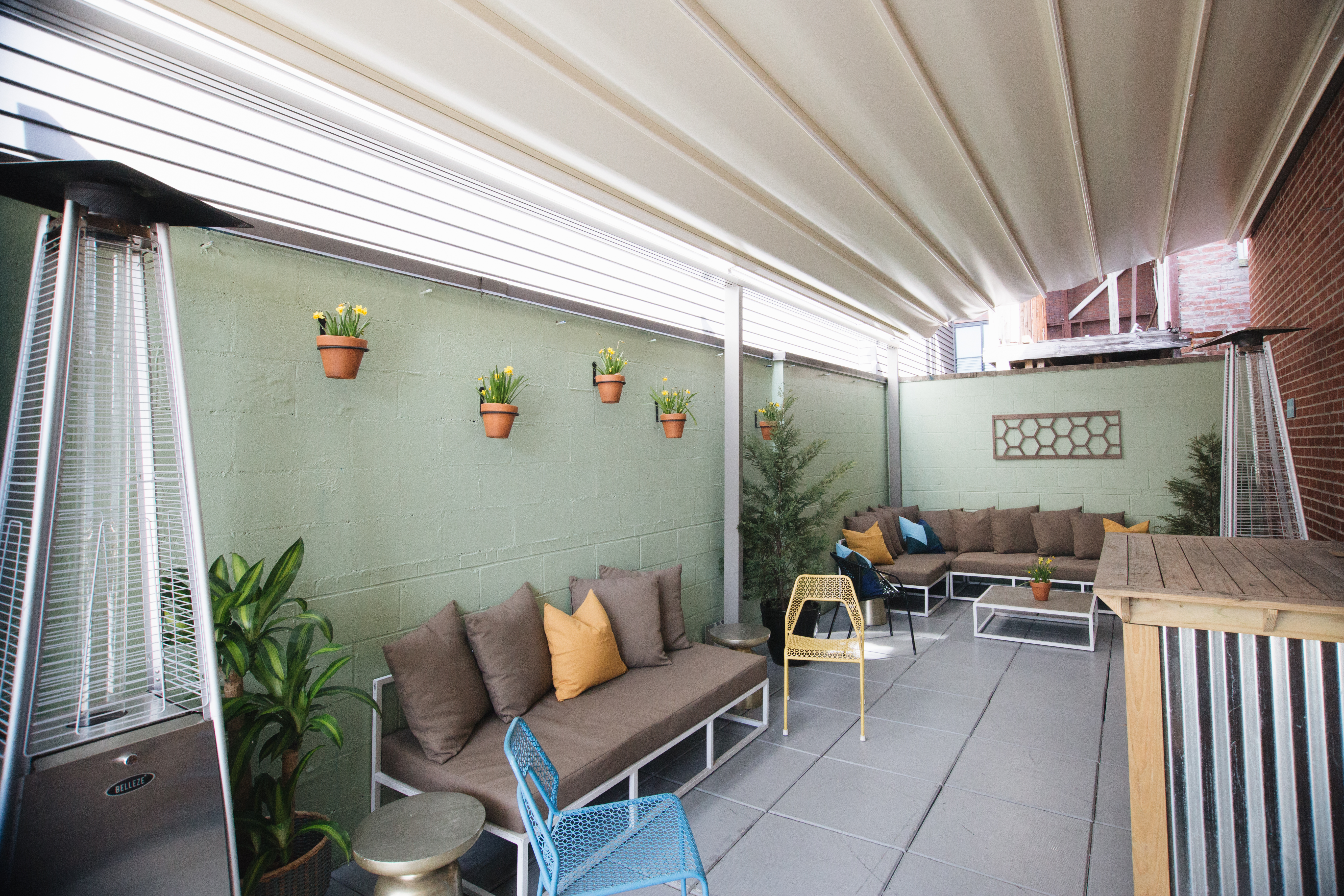 Colada Shop Adds a Retractable Rain Cover to Keep Rooftop Parties Going