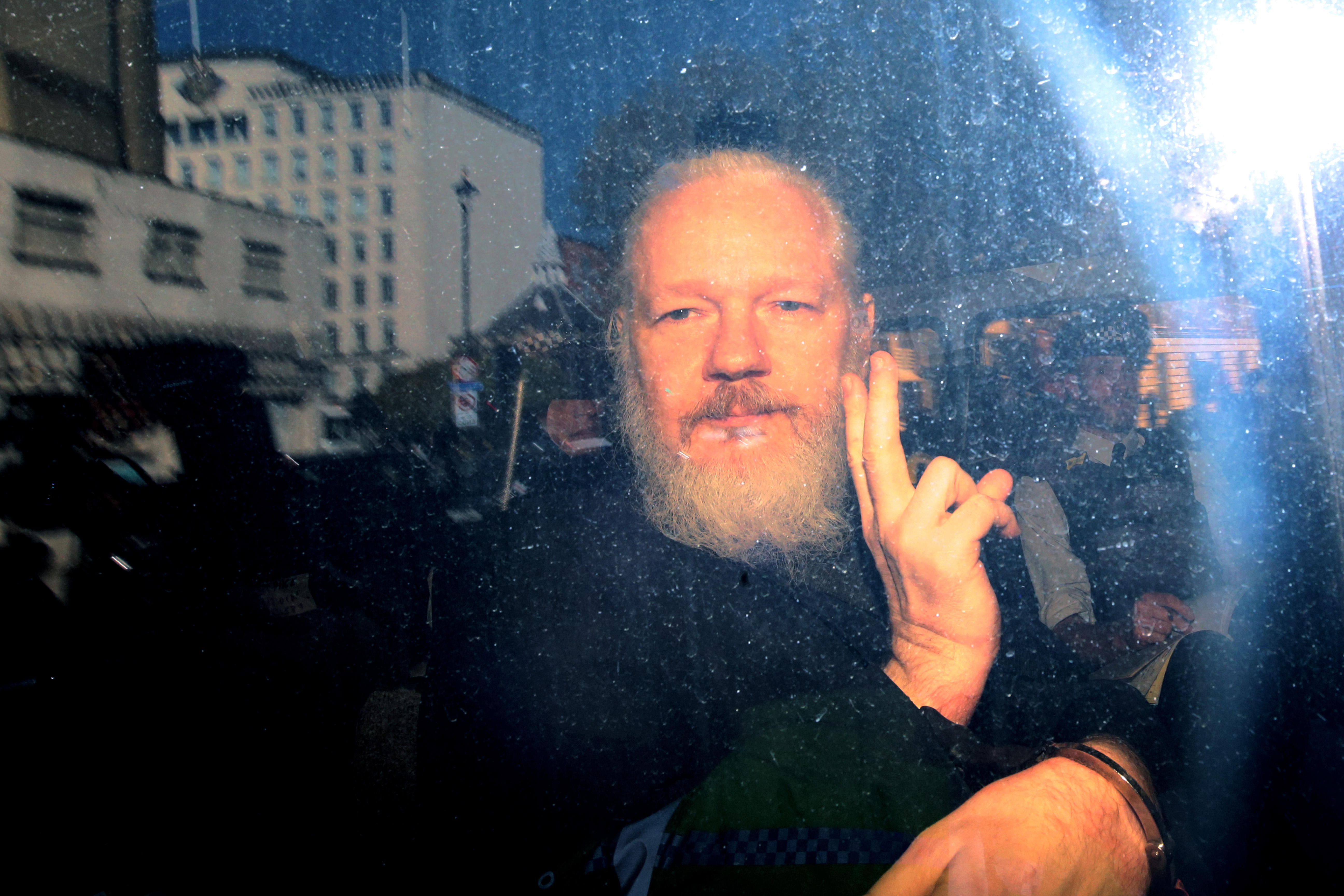 Julian Assange in a police vehicle on April 11, 2019 in London, England