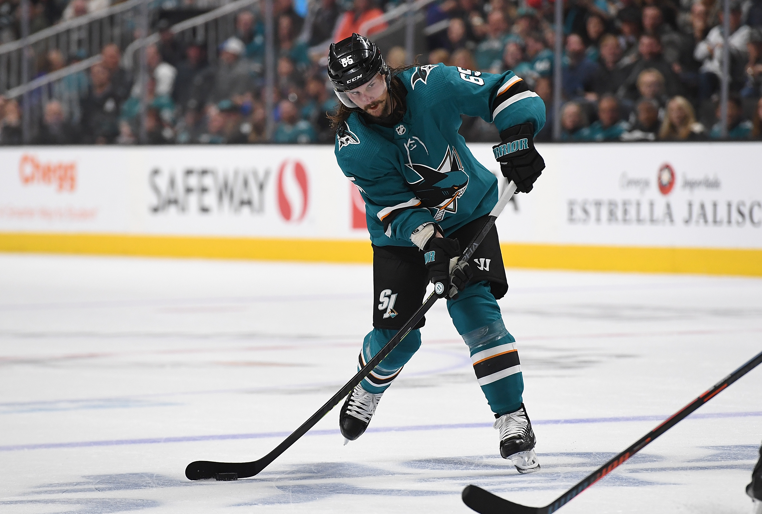 Erik Karlsson of the San Jose Sharks passes the puck to assist on a goal to Evander Kane against the Vegas Golden Knights during the second period in Game 1 of the First Round during the 2019 NHL Stanley Cup Playoffs at SAP Center on April 10, 2019