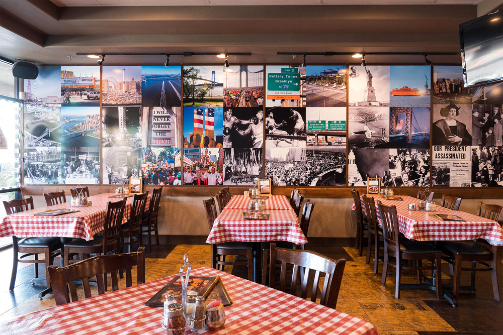 The east-coast inspired mural at Carmine's Pizza Kitchen, expanding to West Henderson next summer.