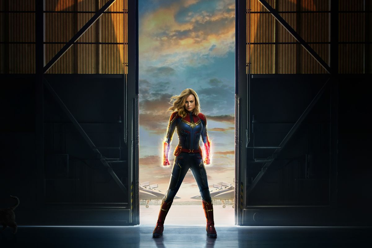 """Poster for the movie """"Captain Marvel"""" shows the title character standing in a doorway."""
