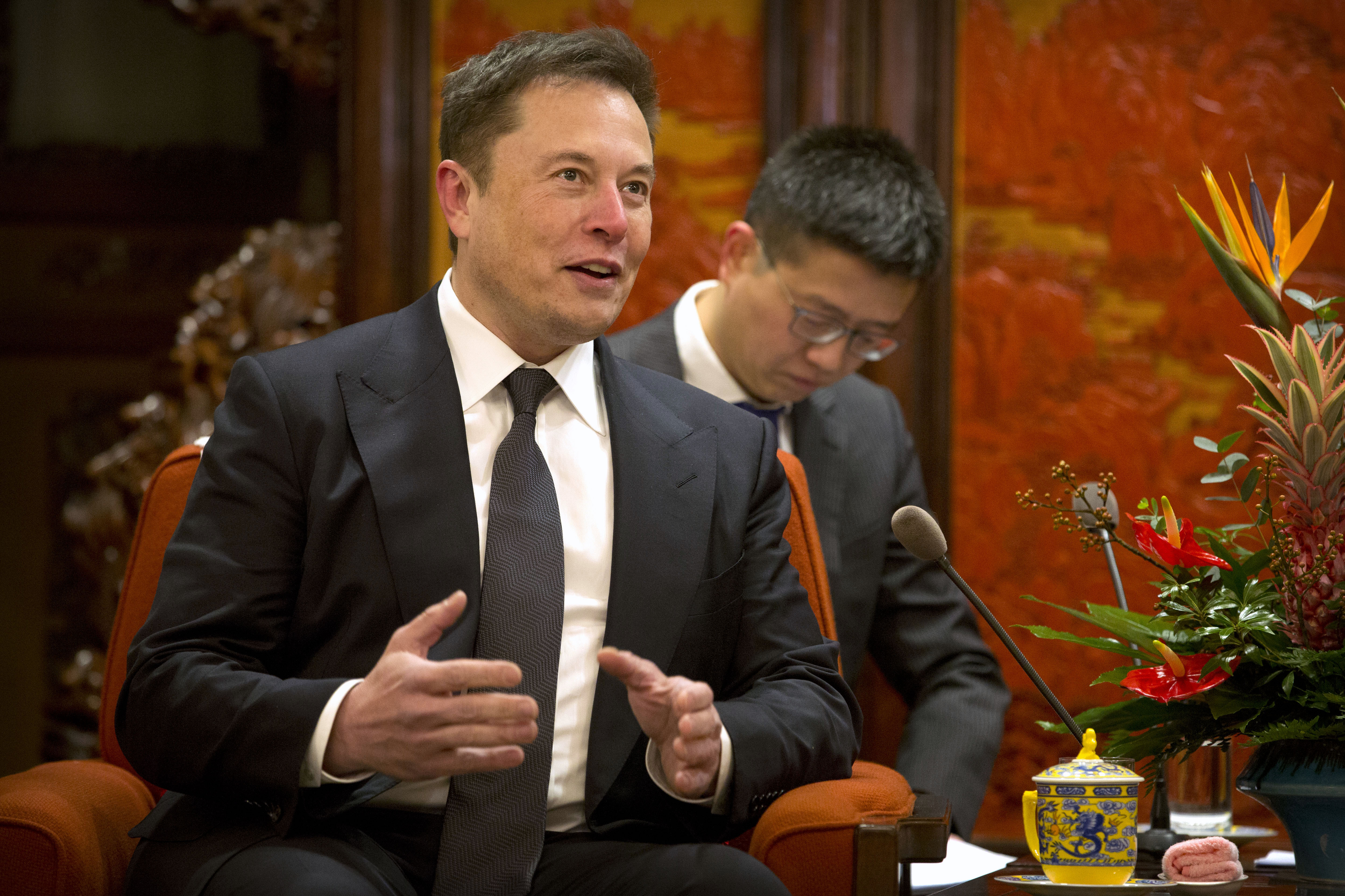 Tesla CEO Elon Musk speaks during a meeting with Chinese Premier Li Keqiang.