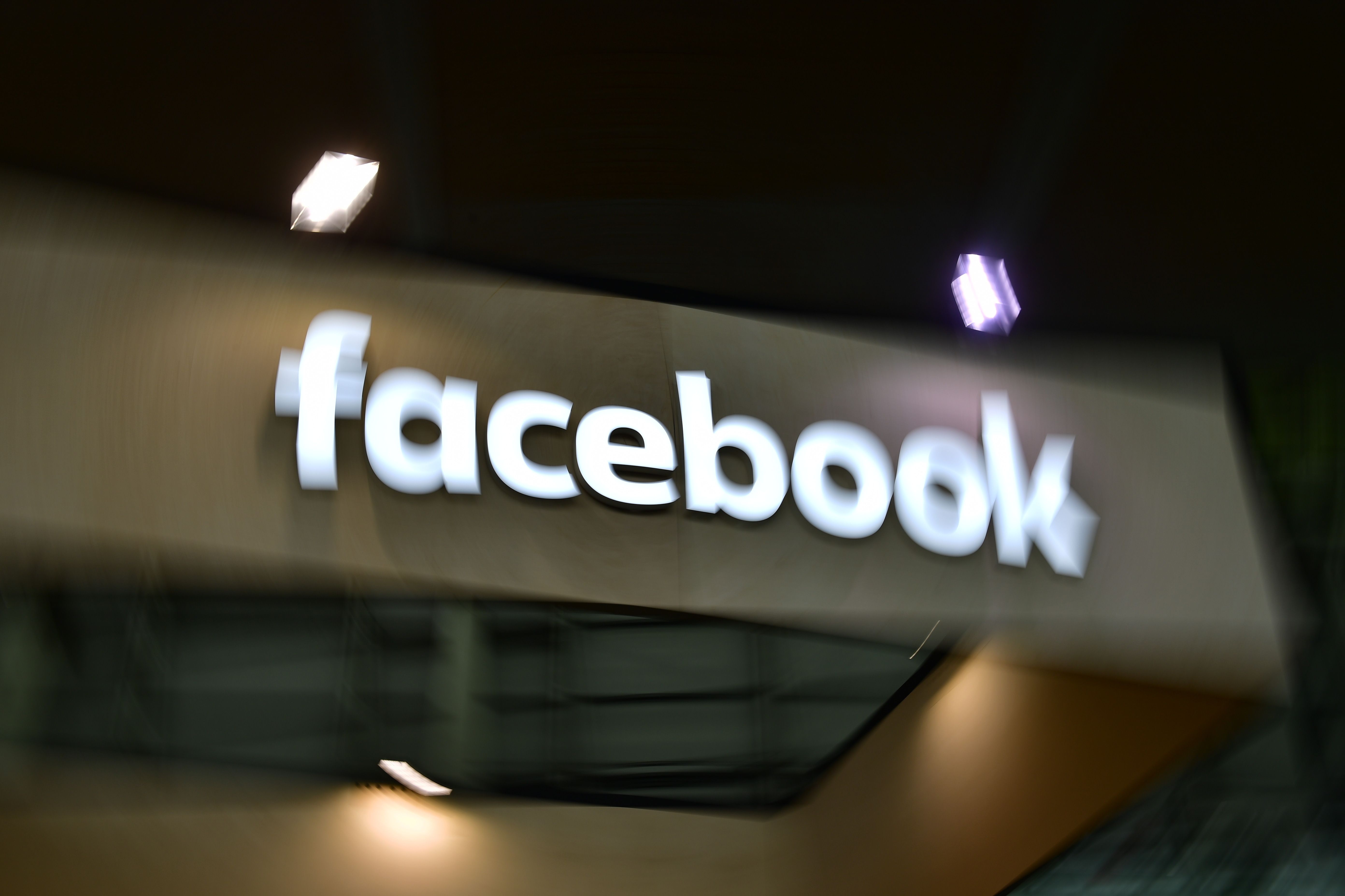 A Facebook sign at a trade show.