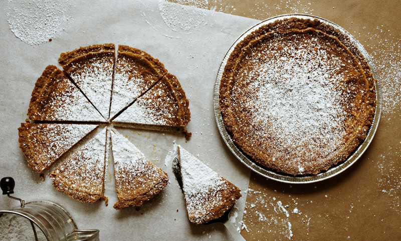 Milk Bar's signature pie, dusted with sugar and viewed from overhead