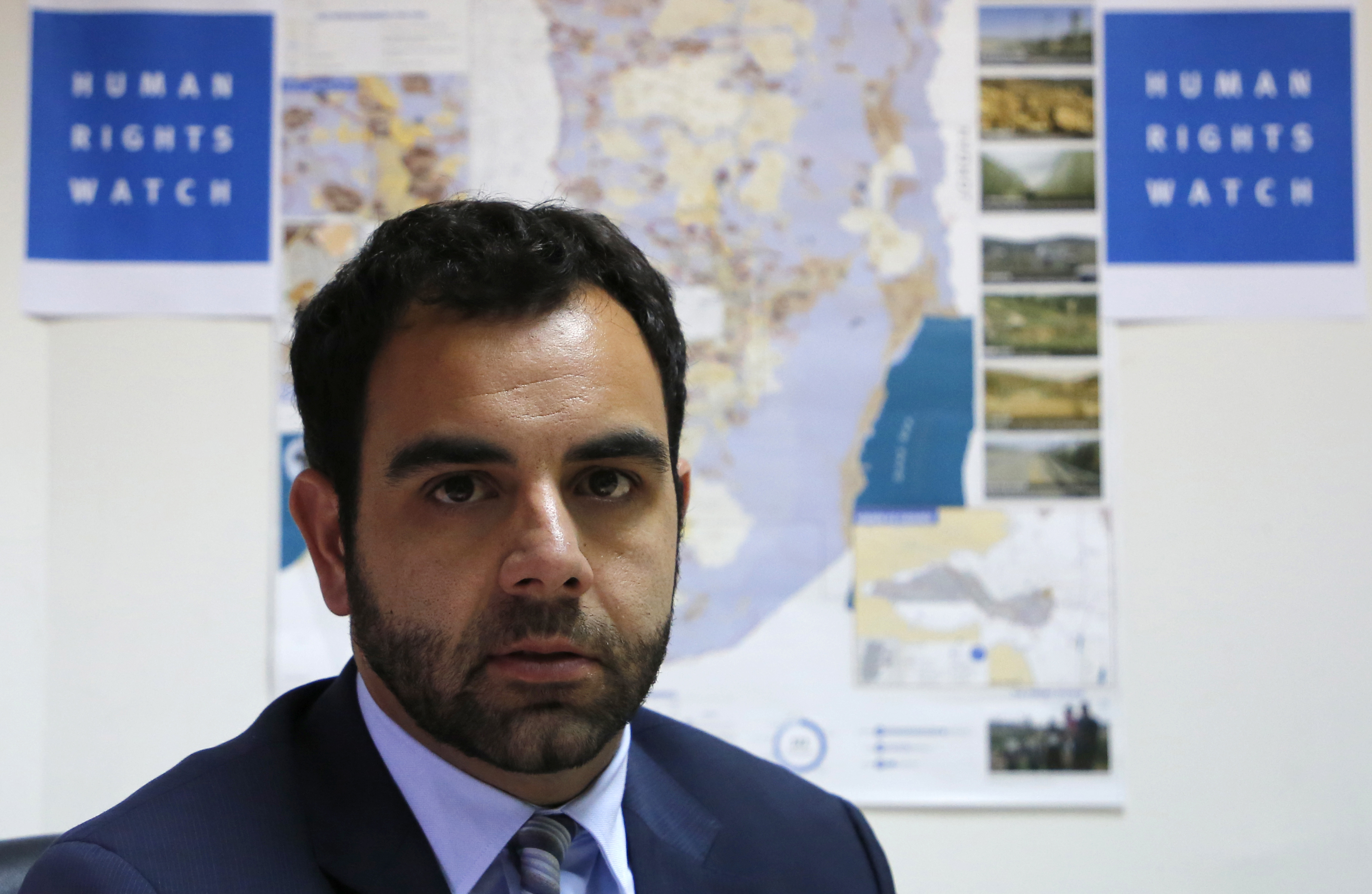 Human Rights Watch's Israel and Palestine director Omar Shakir, a US citizen, sits at his office in the West Bank city of Ramallah on May 9, 2018.