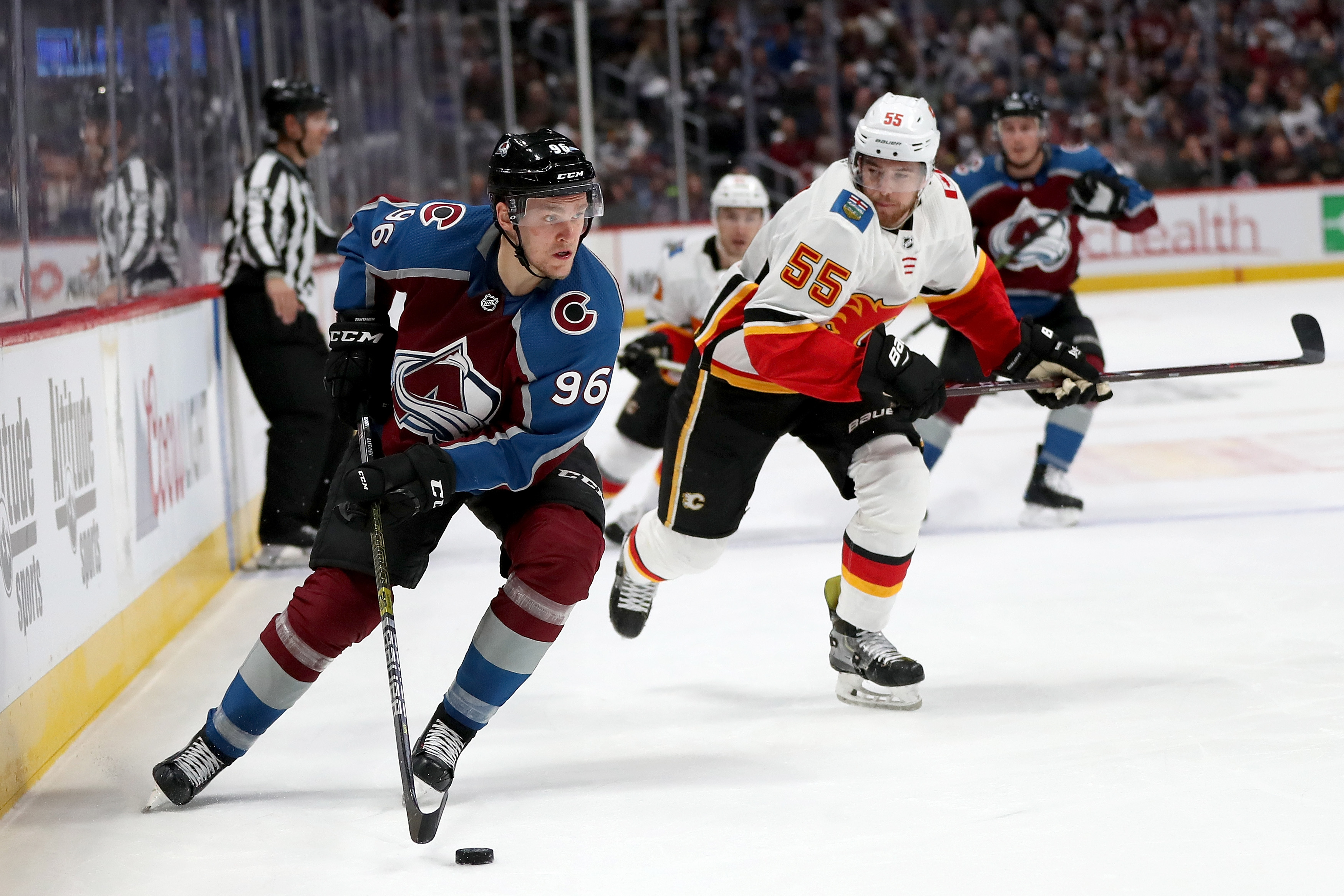 DENVER, COLORADO - APRIL 15: Mikko Rantanen #96 of the Colorado Avalanche advances the puck against the Calgary Flames in the second period during Game Three of the Western Conference First Round during the 2019 NHL Stanley Cup Playoffs at the Pepsi Cente