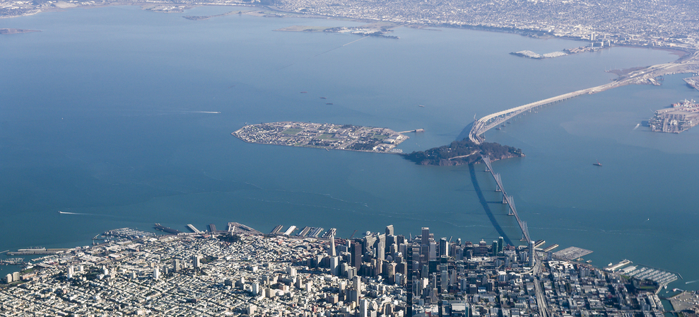 An aerial photo of the SF waterfront, the bay, and Treasure Island.