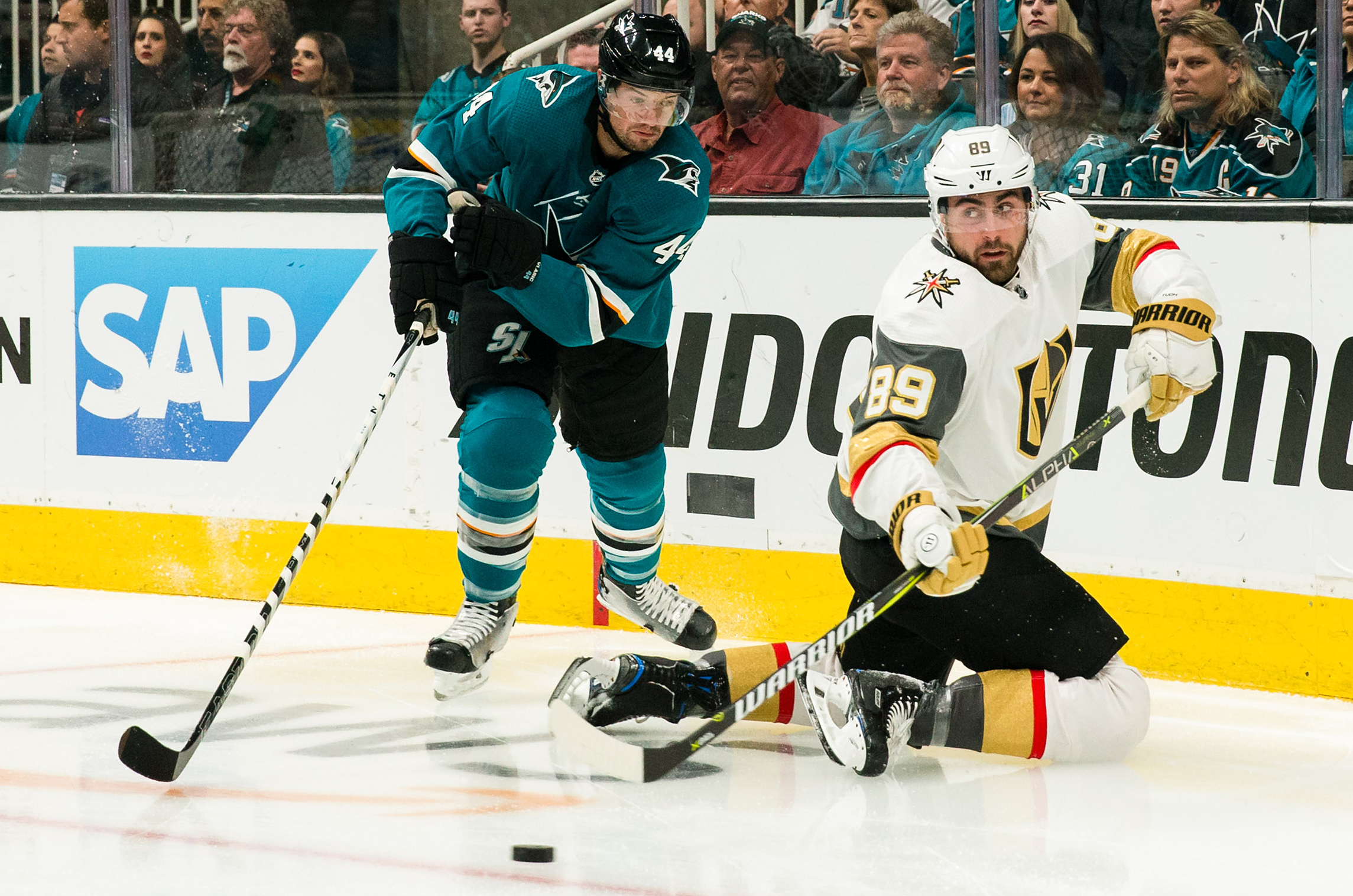 San Jose Sharks defenseman Marc-Edouard Vlasic (44) and Vegas Golden Knights right wing Alex Tuch (89) battle for control of the puck in the first period of game five of the first round of the 2019 Stanley Cup Playoffs at SAP Center at San Jose.