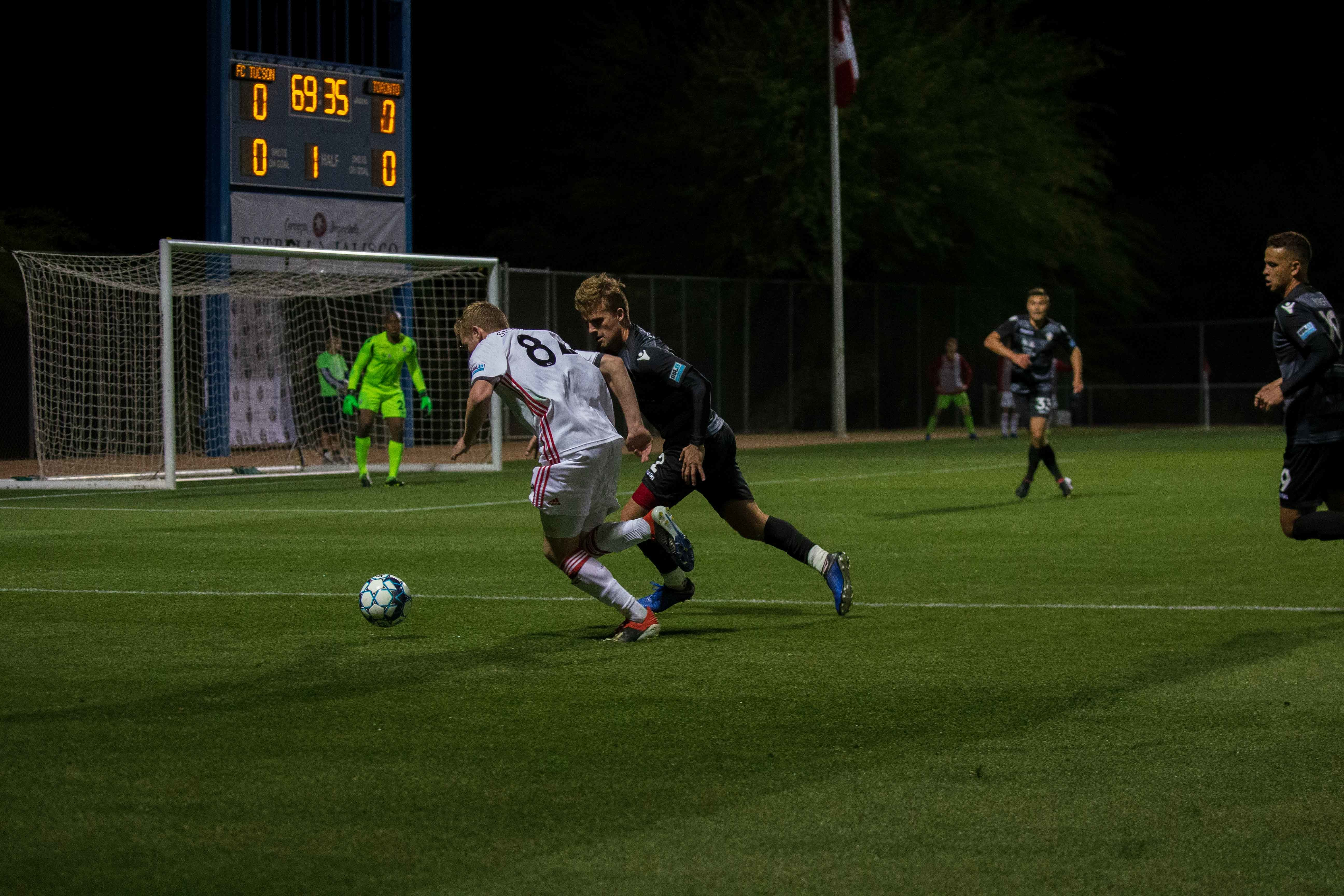 USL League One Photo - Toronto FC II's Jacob Shaffelberg duels with FC Tucson's Austin Ledbetter up the left flank in Saturday night's 1-1 draw