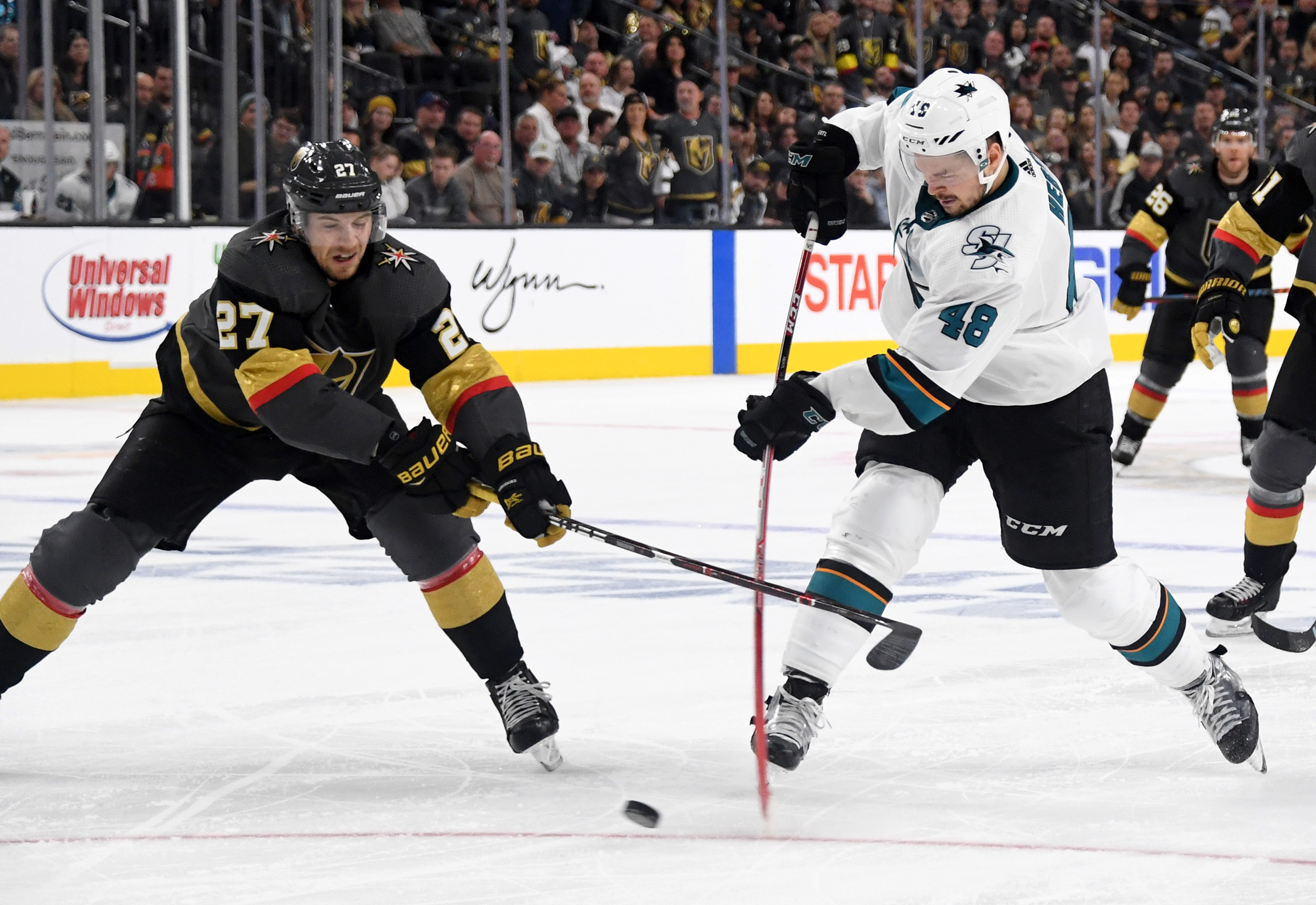 LAS VEGAS, NEVADA - APRIL 21: Tomas Hertl #48 of the San Jose Sharks shoots a game-winning short-handed goal at 11:17 of the second overtime period against Shea Theodore #27 of the Vegas Golden Knights in Game Six of the Western Conference First Round dur