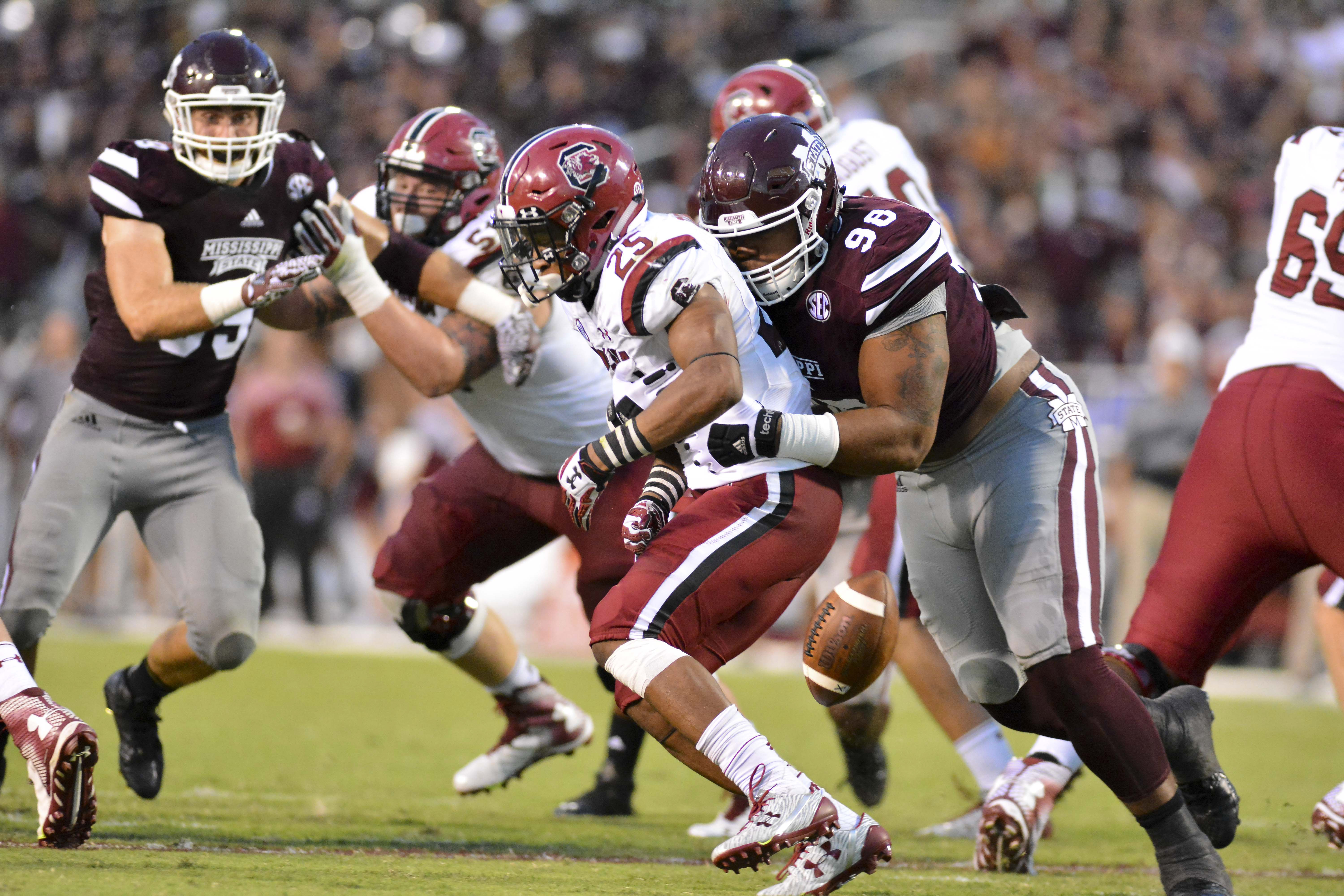 Mississippi St. Bulldogs CL Jeffery Simmons forces a fumble from South Carolina Gamecocks RB A.J. Turner, Sep. 10, 2016.