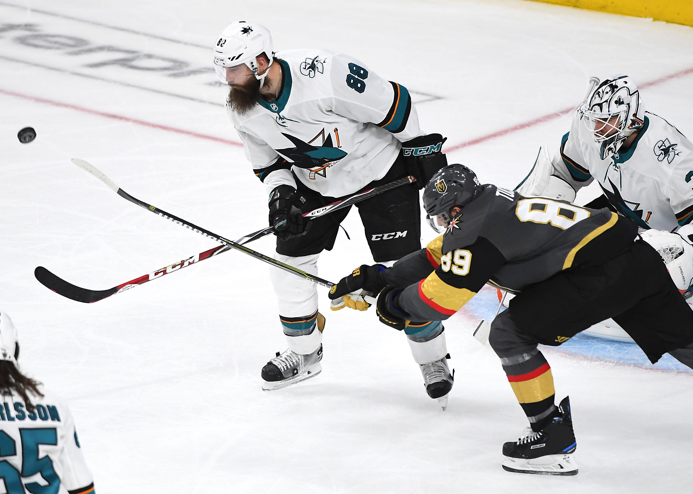San Jose Sharks defenseman Brent Burns (88) clears the puck away from Vegas Golden Knights right wing Alex Tuch (89) during the first overtime period of game six of the first round of the 2019 Stanley Cup Playoffs at T-Mobile Arena.