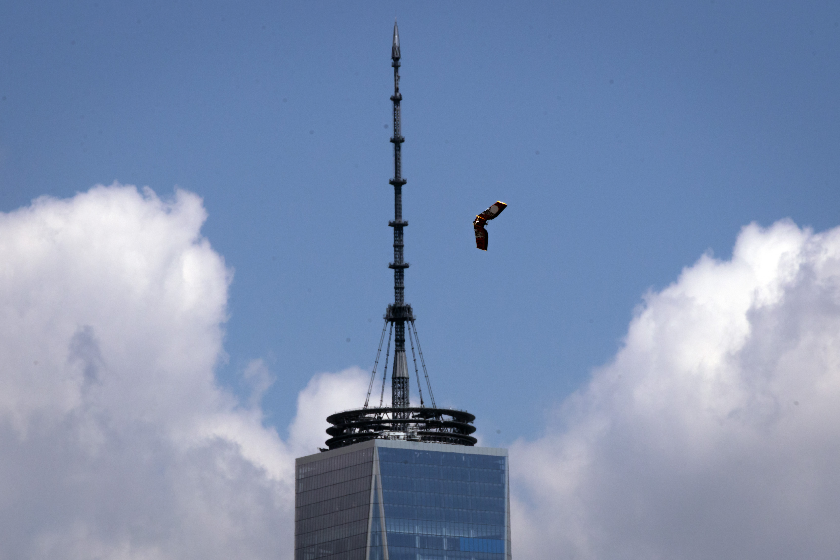 A winged drone flying past the spire of One World Trade Center in New York City in 2016.
