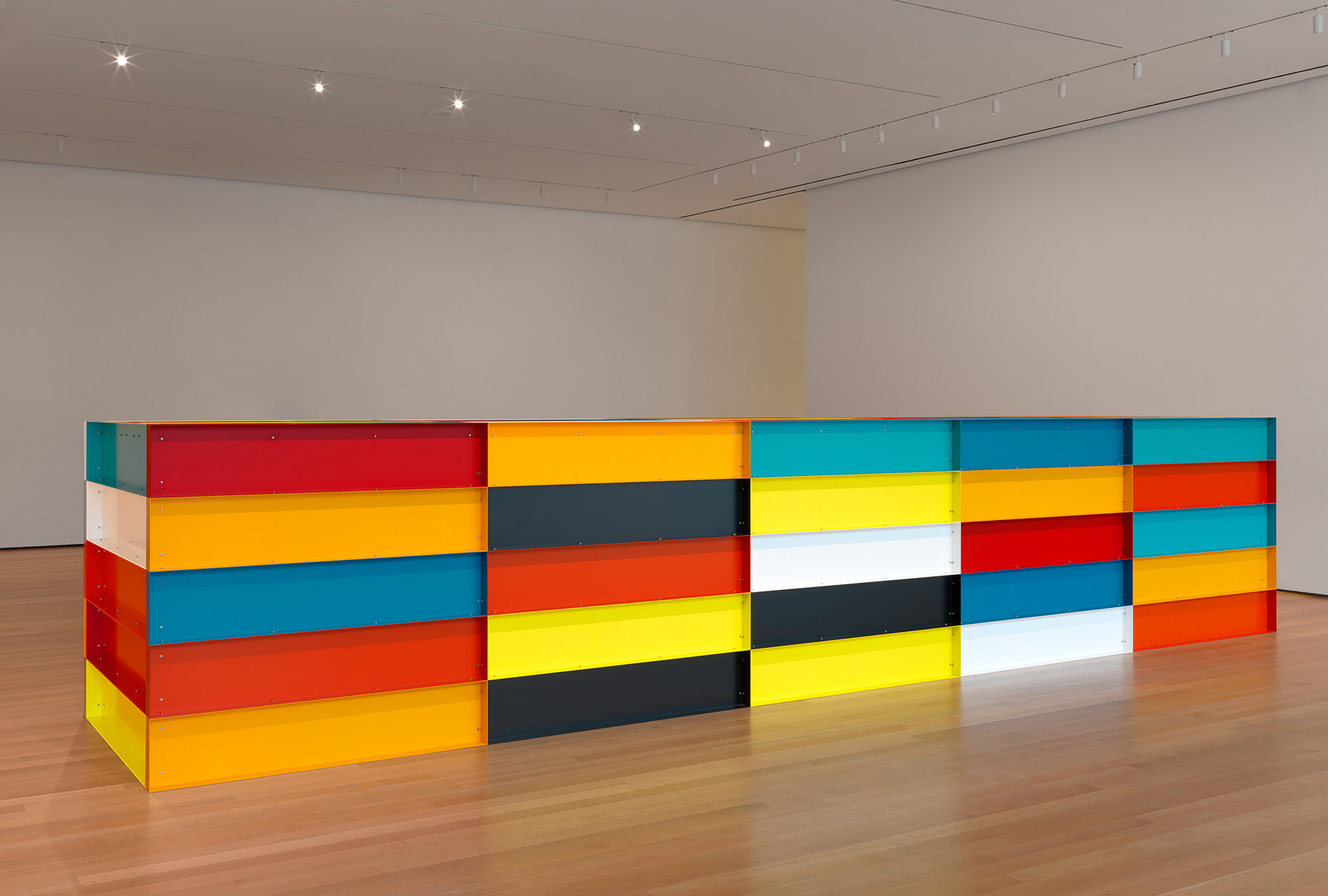 Donald Judd sculpture made of aluminum painted in different colors.