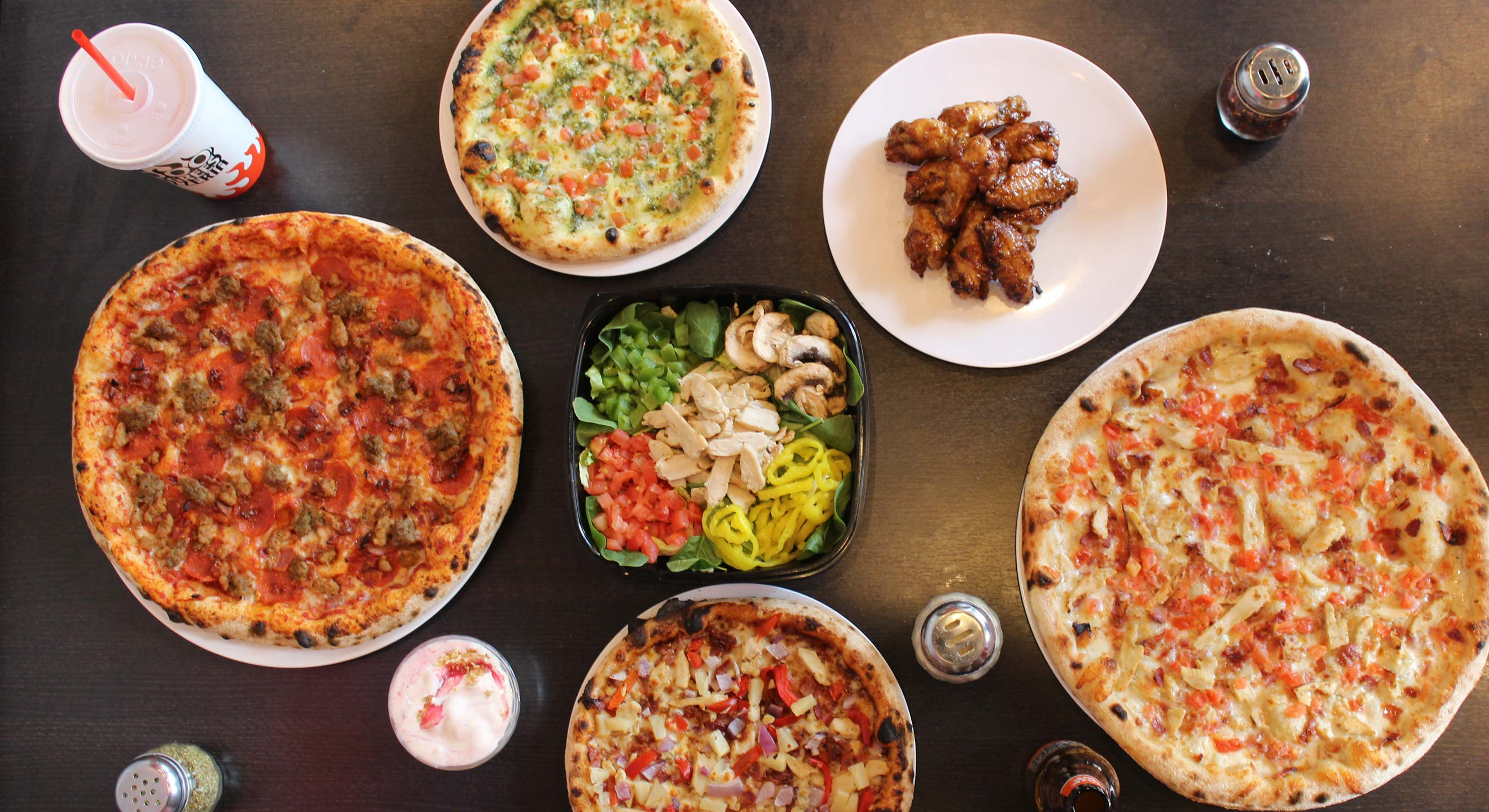 A spread of food at 1000 Degrees Neapolitan Pizza