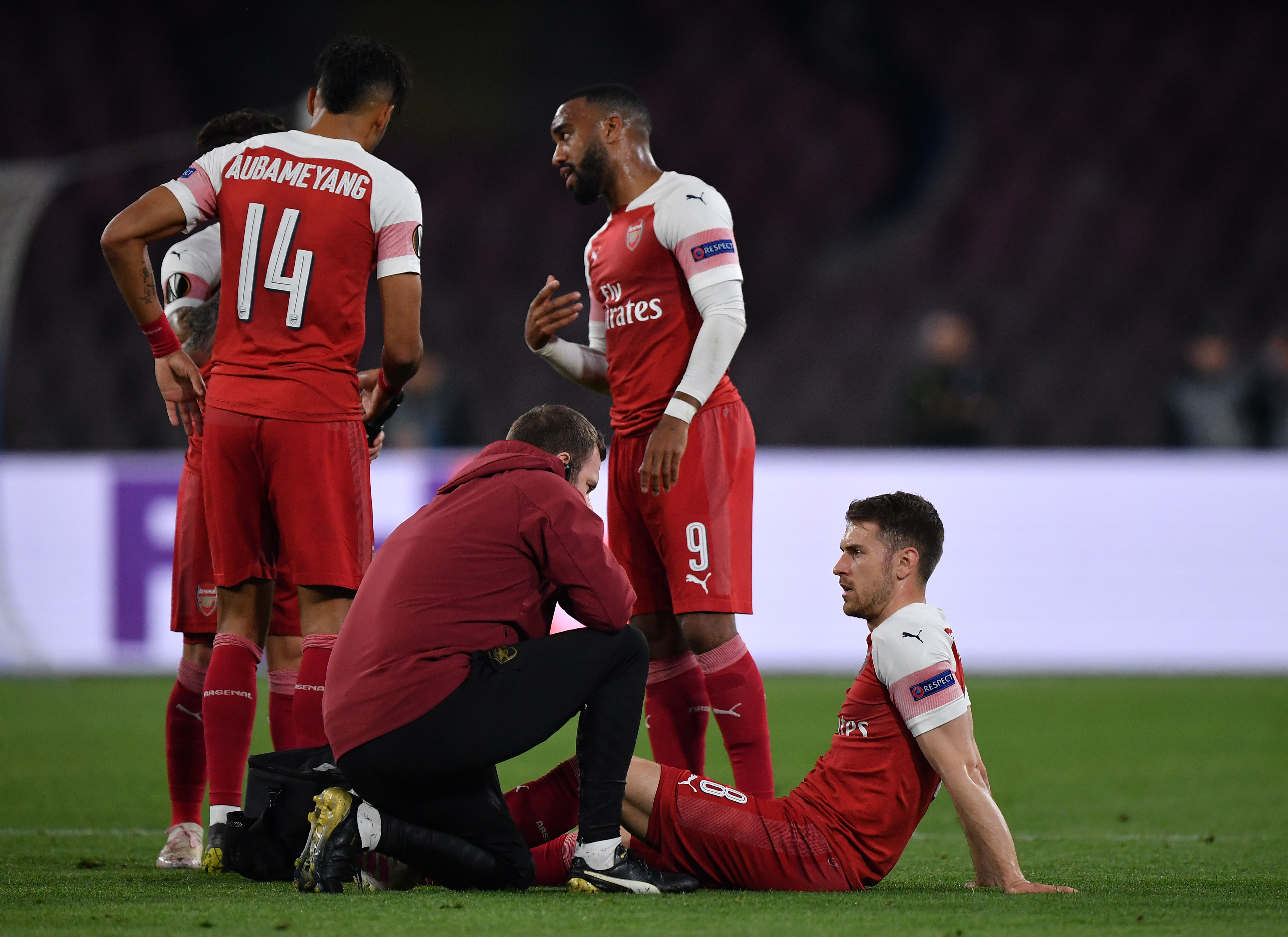 Arsenal MF Aaron Ramsey recieves treatment during the UEFA Europa League Quarter Final Second Leg match against Napoli, Apr. 18, 2019.