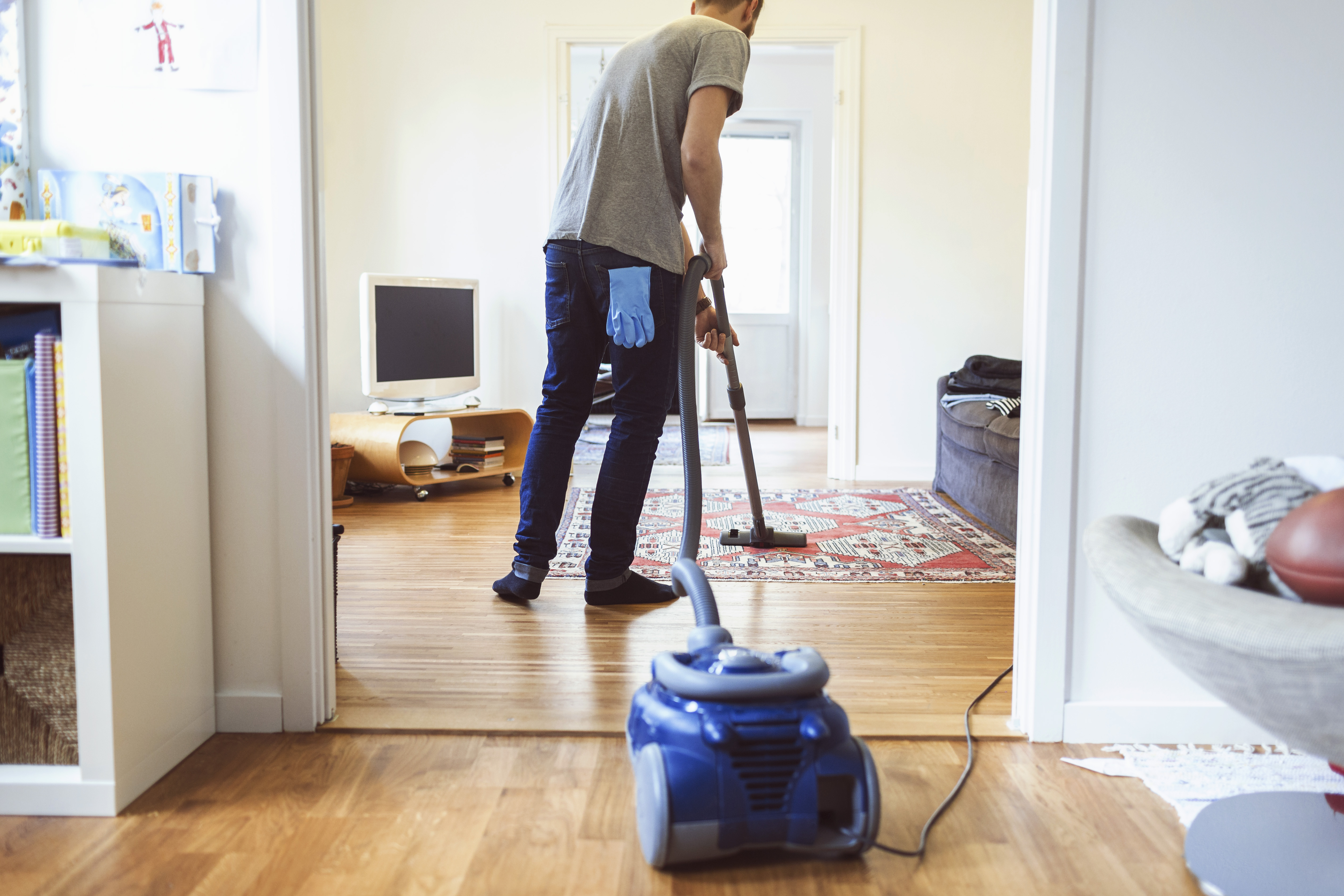 A man cleaning a house.