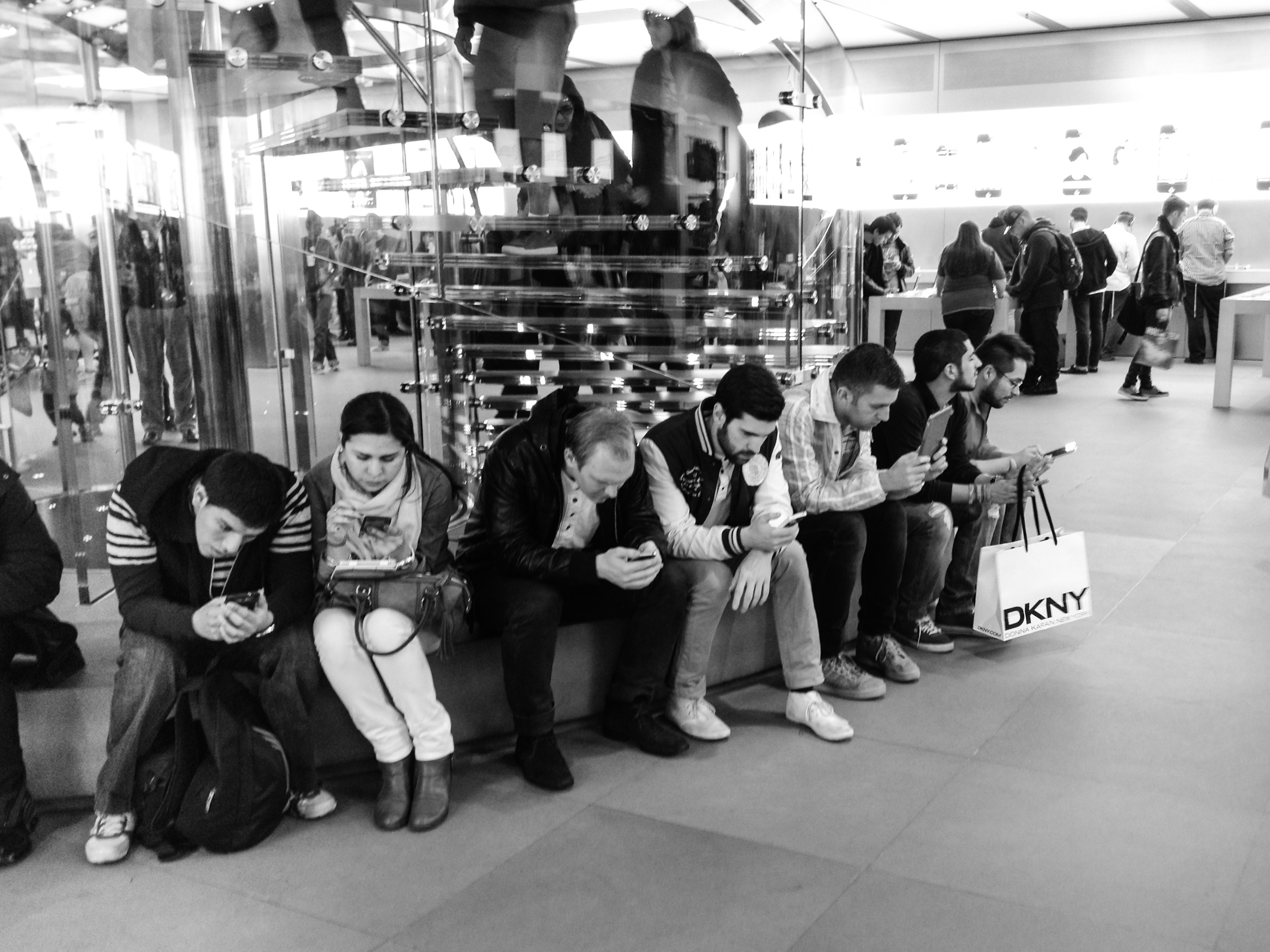 People look at their smartphones and tablets at the Apple Store on Fifth Avenue in New York City in September 2013.