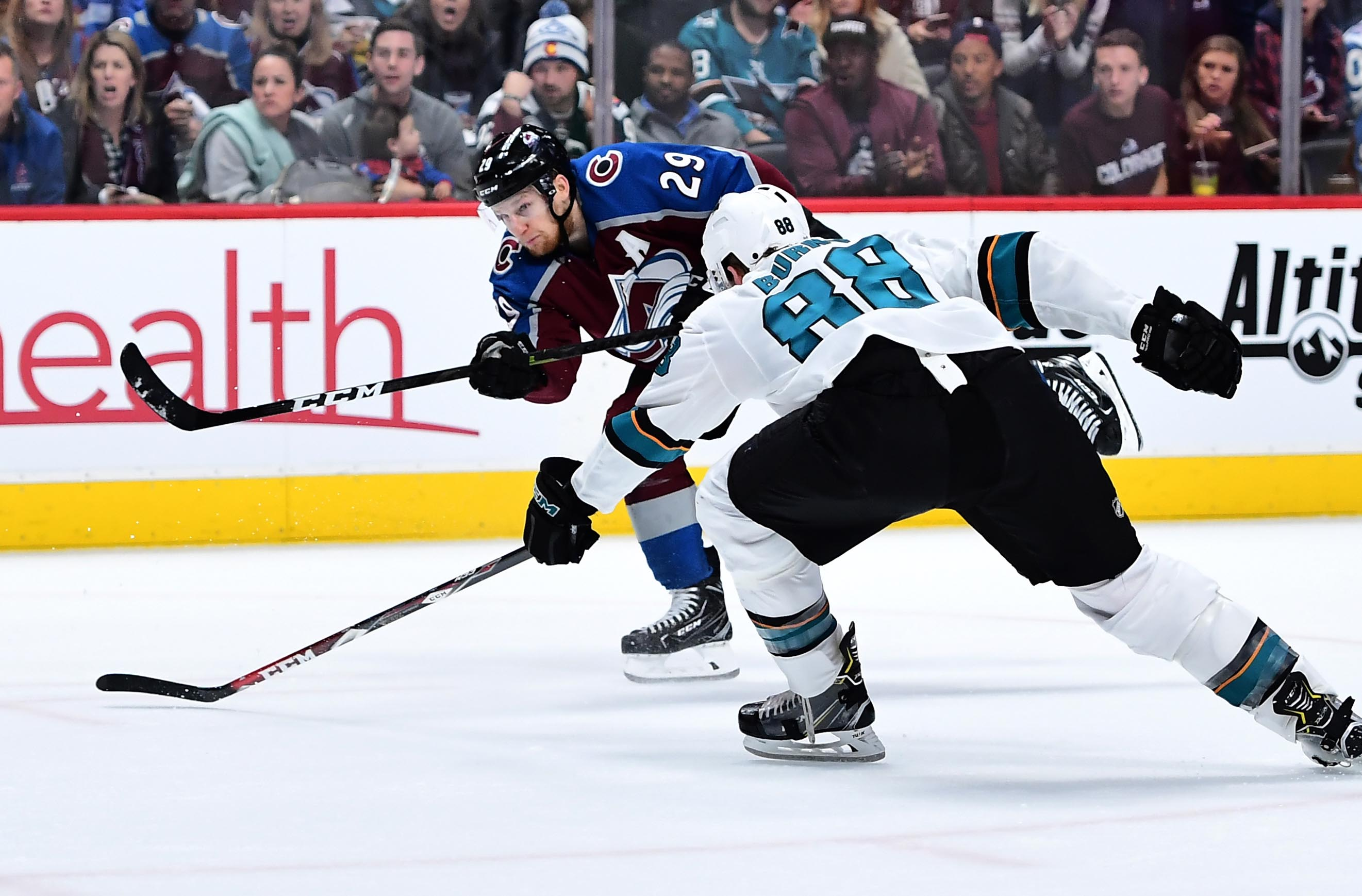 Colorado Avalanche center Nathan MacKinnon (29) shoots and scores past San Jose Sharks defenseman Brent Burns (88) in the second period in game three of the second round of the 2019 Stanley Cup Playoffs at Pepsi Center.