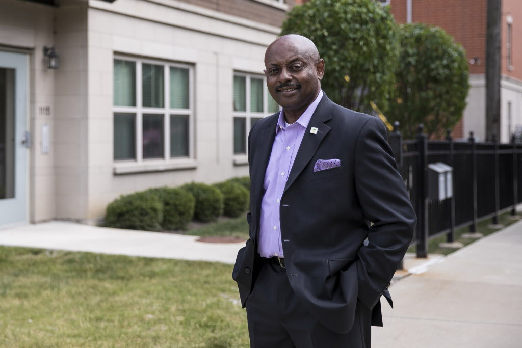 """Eugene Jones Jr., CEO of the Chicago Housing Authority, outside homes in Roosevelt Square, which replaced the old ABLA homes under the CHA's """"Plan for Transformation."""""""