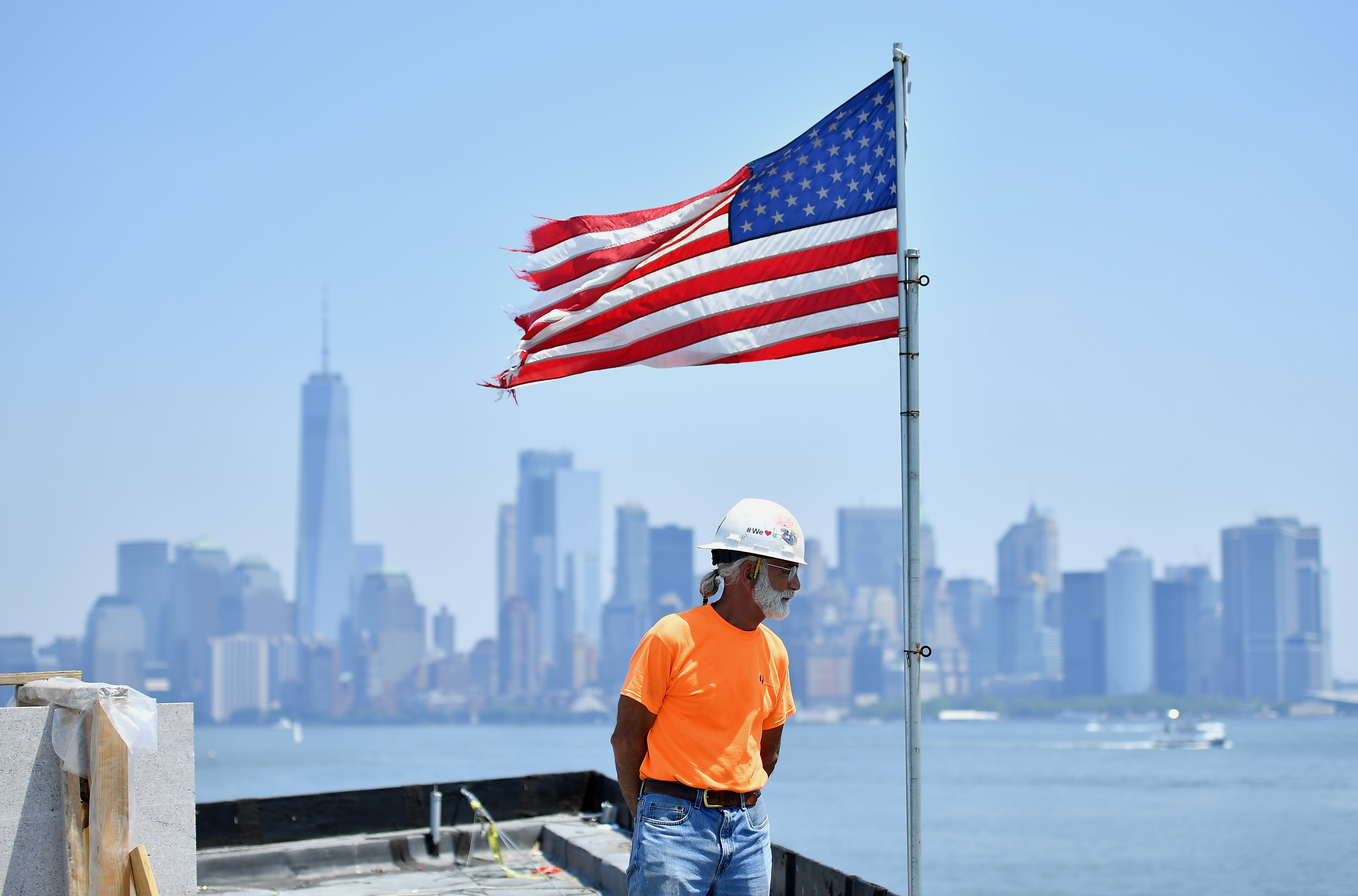 A worker is seen on the construction site of the new Statue of Liberty Museum currently being built on Liberty Island on July 2, 2018 in New York City. - The new 26,000-square-foot museum will celebrate the Statue of Libertys history, influence, and legac