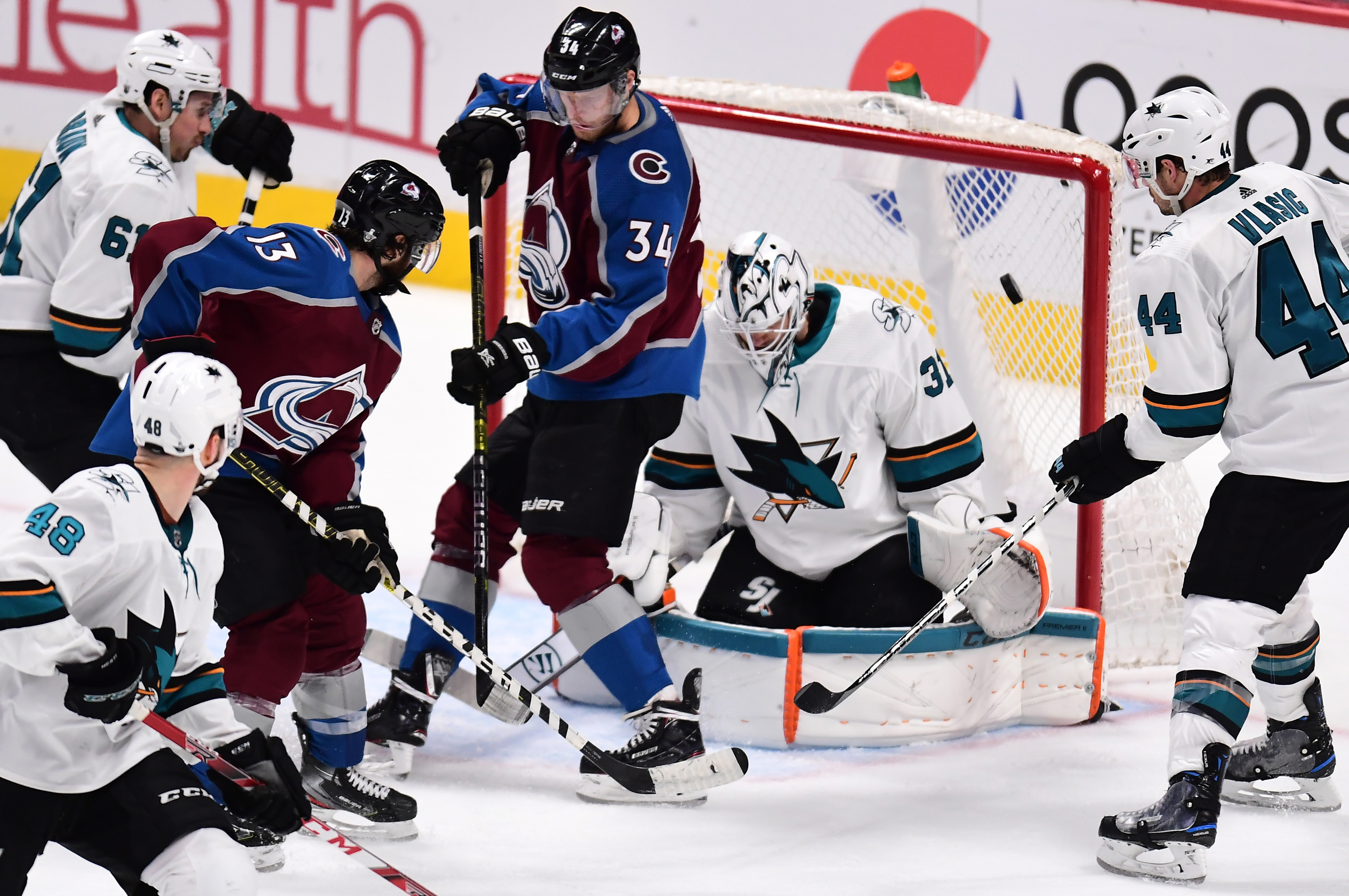 San Jose Sharks goaltender Martin Jones (31) and San Jose Sharks defenseman Marc-Edouard Vlasic (44) defend the net as center Alexander Kerfoot (13) and center Carl Soderberg (34) attempt to score in the third period in game three of the second round of t