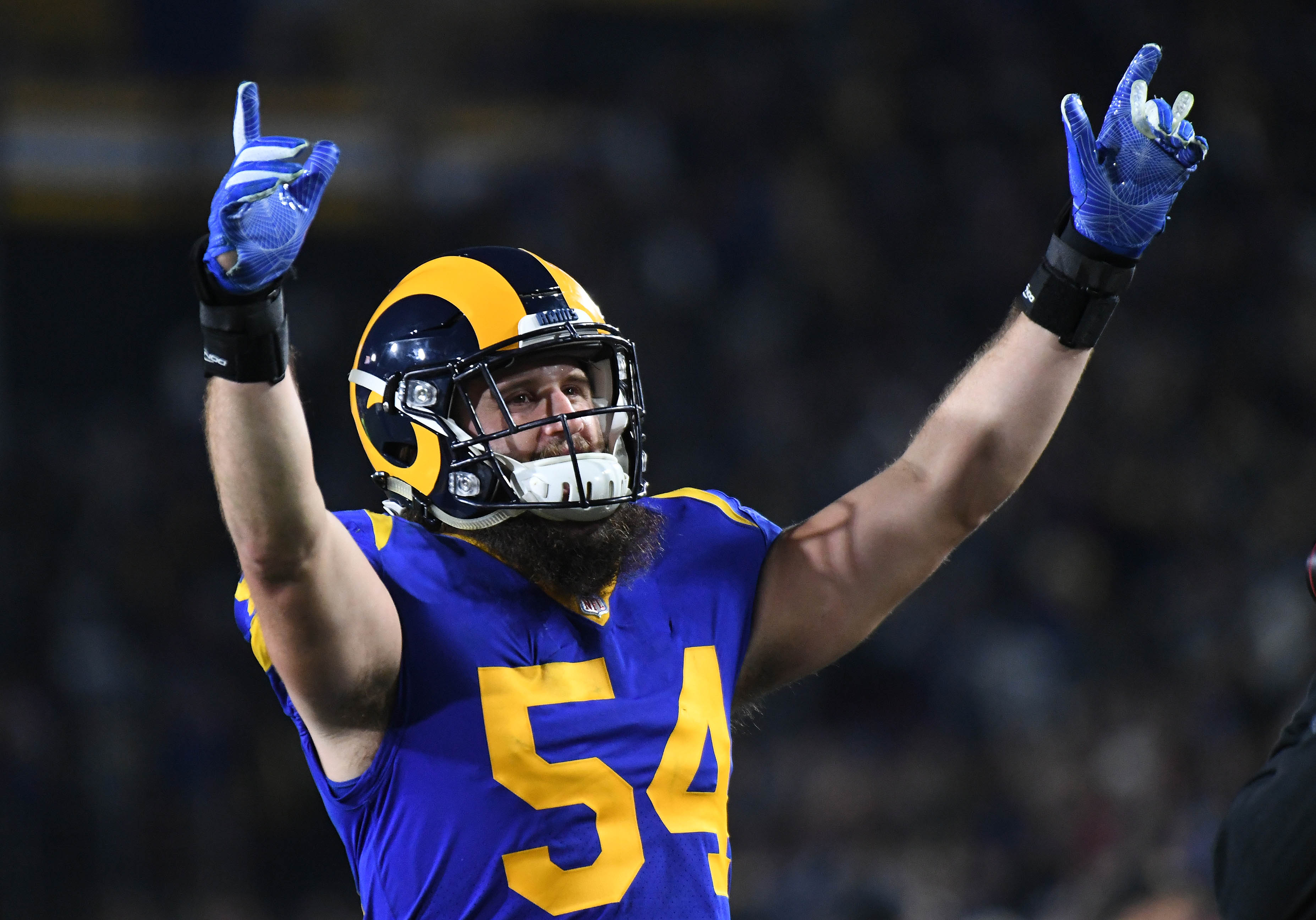 Los Angeles Rams LB Bryce Hager celebrates after a win against the Dallas Cowboys in a NFC Divisional playoff football game, Jan. 12, 2019.