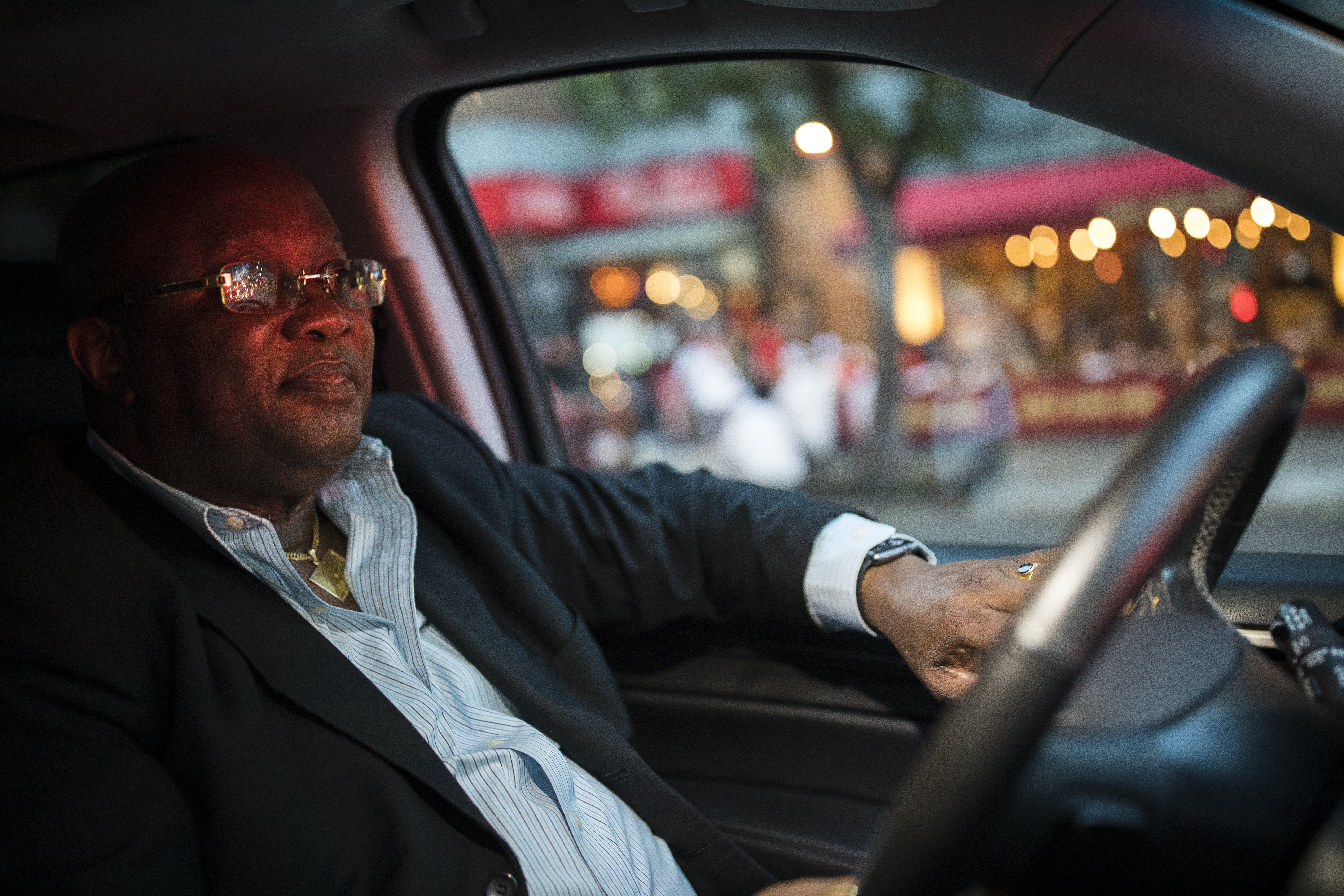 An Uber driver inside a car in New York City.