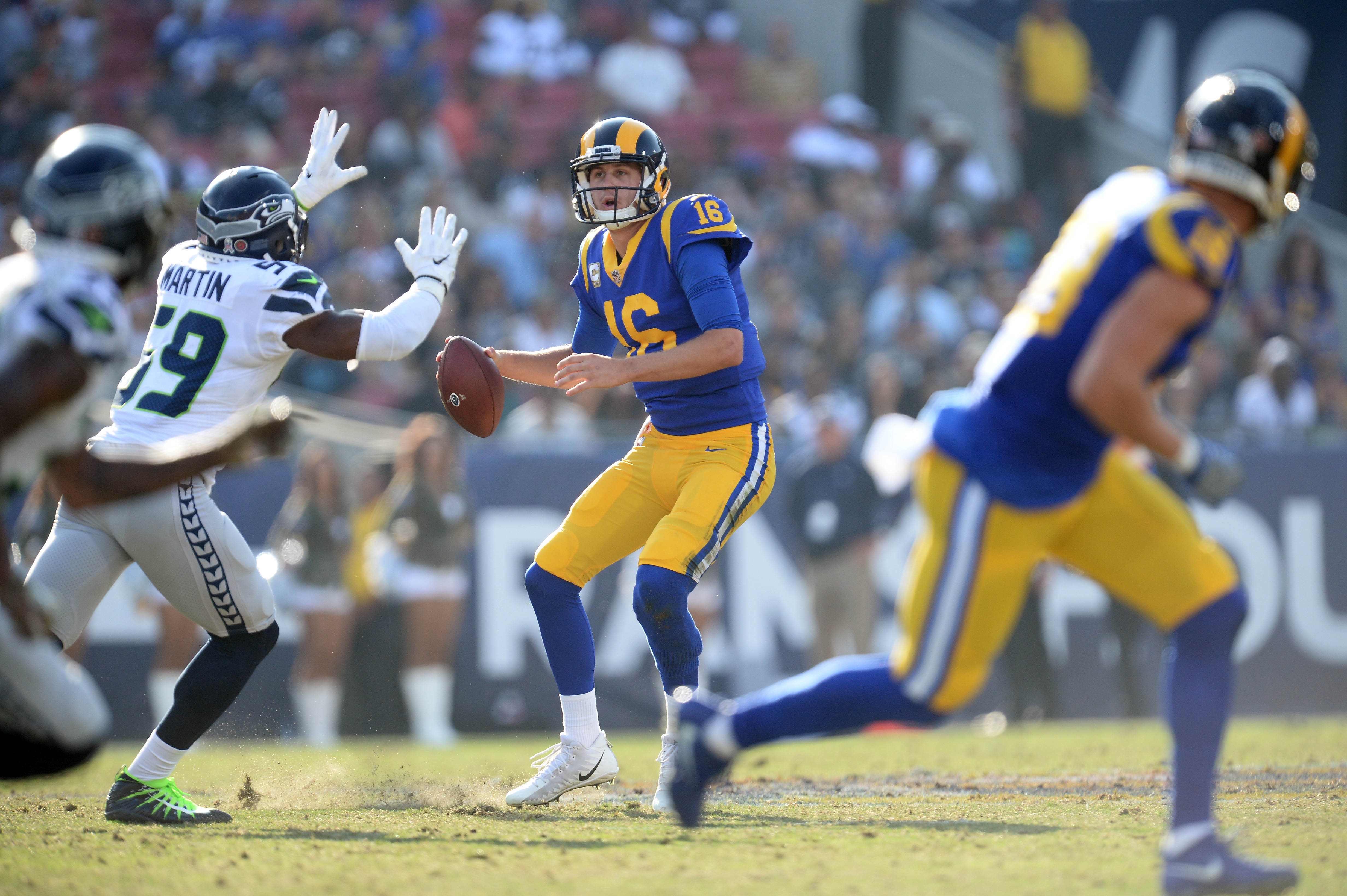 Los Angeles Rams QB Jared Goff drops back against the Seattle Seahawks, Nov. 11, 2018.