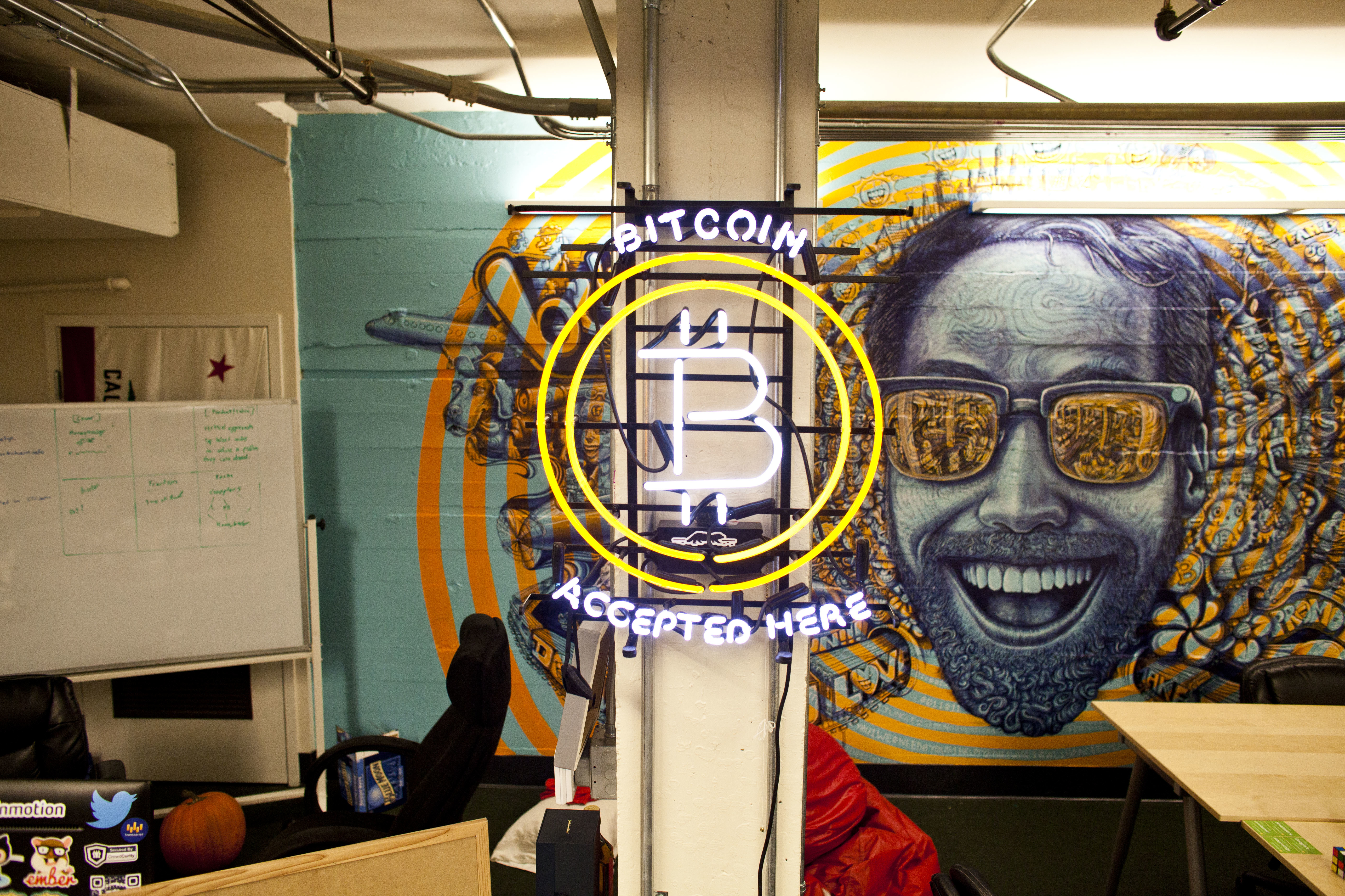 A neon bitcoin logo is displayed at Boost VC bootcamp in California in 2014.