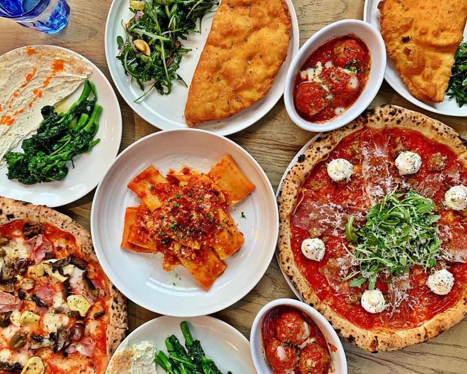 An array of Italian dishes at Sixth + Mill Pizzeria & Bar
