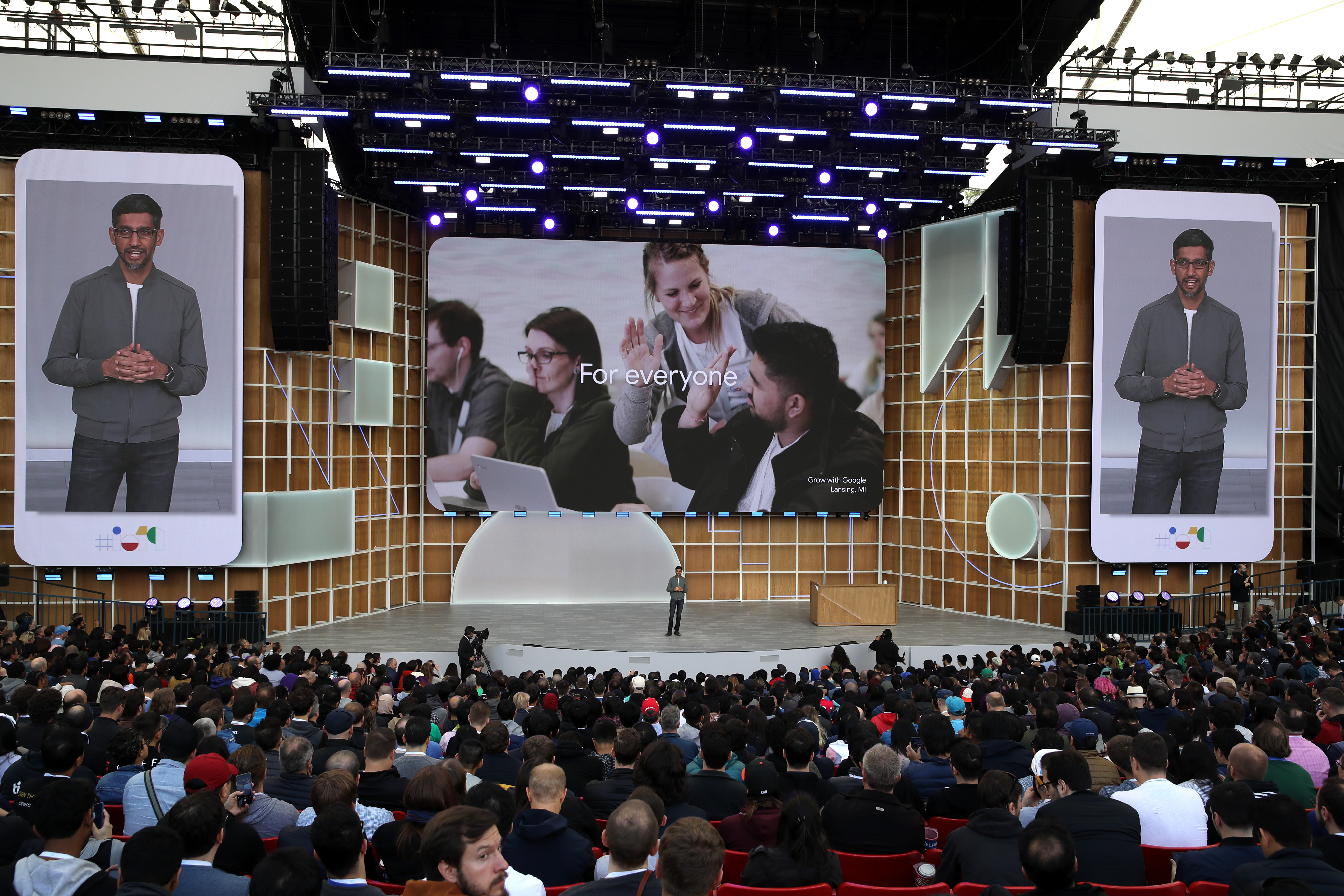 The stage at Google's annual I/O developers conference showing CEO Sundar Pichai in flanking video images.