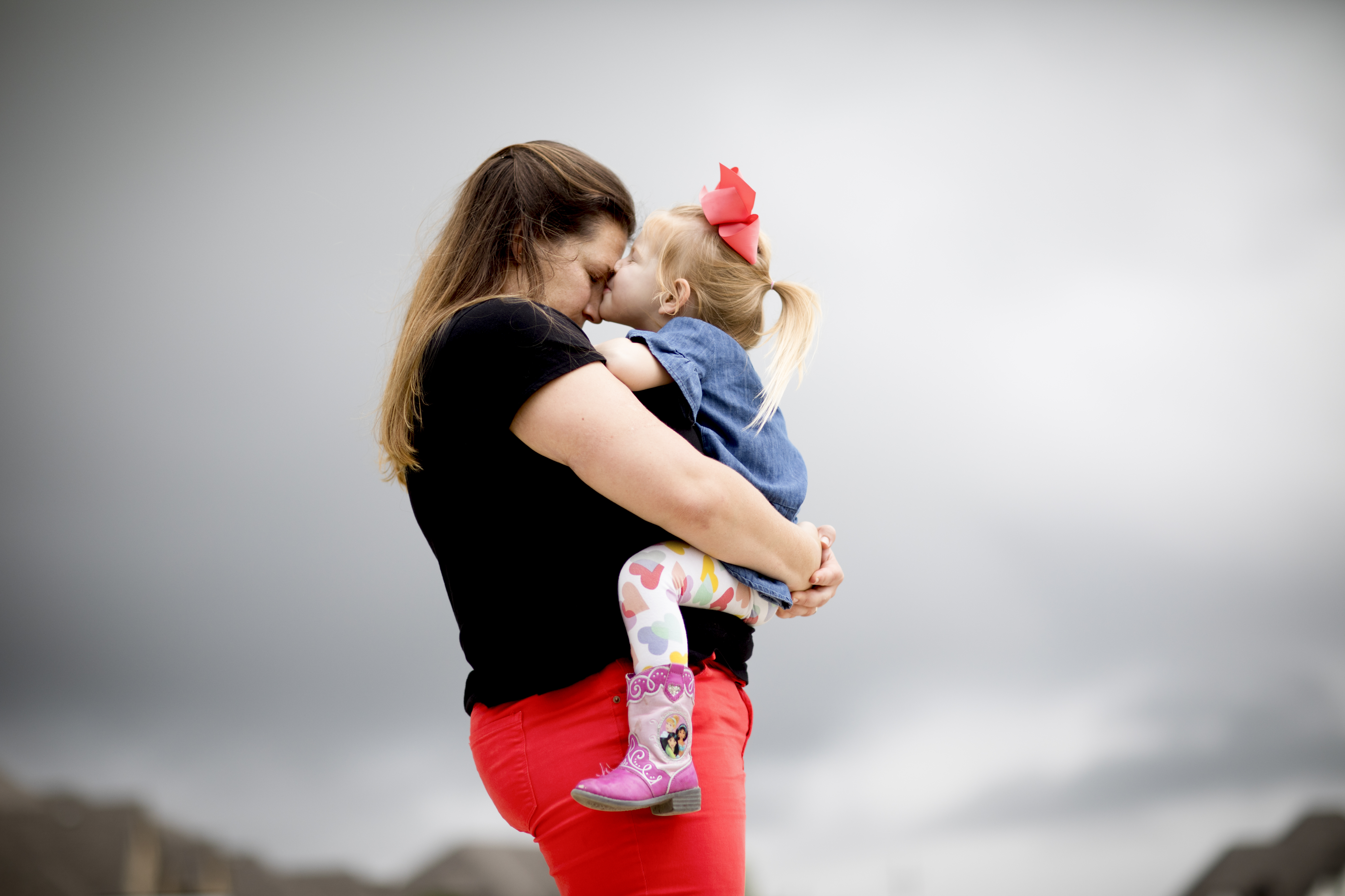 Lindsay Clark gets a kiss from her daughter Lily outside their home in Aledo, Texas, on May 9, 2019.