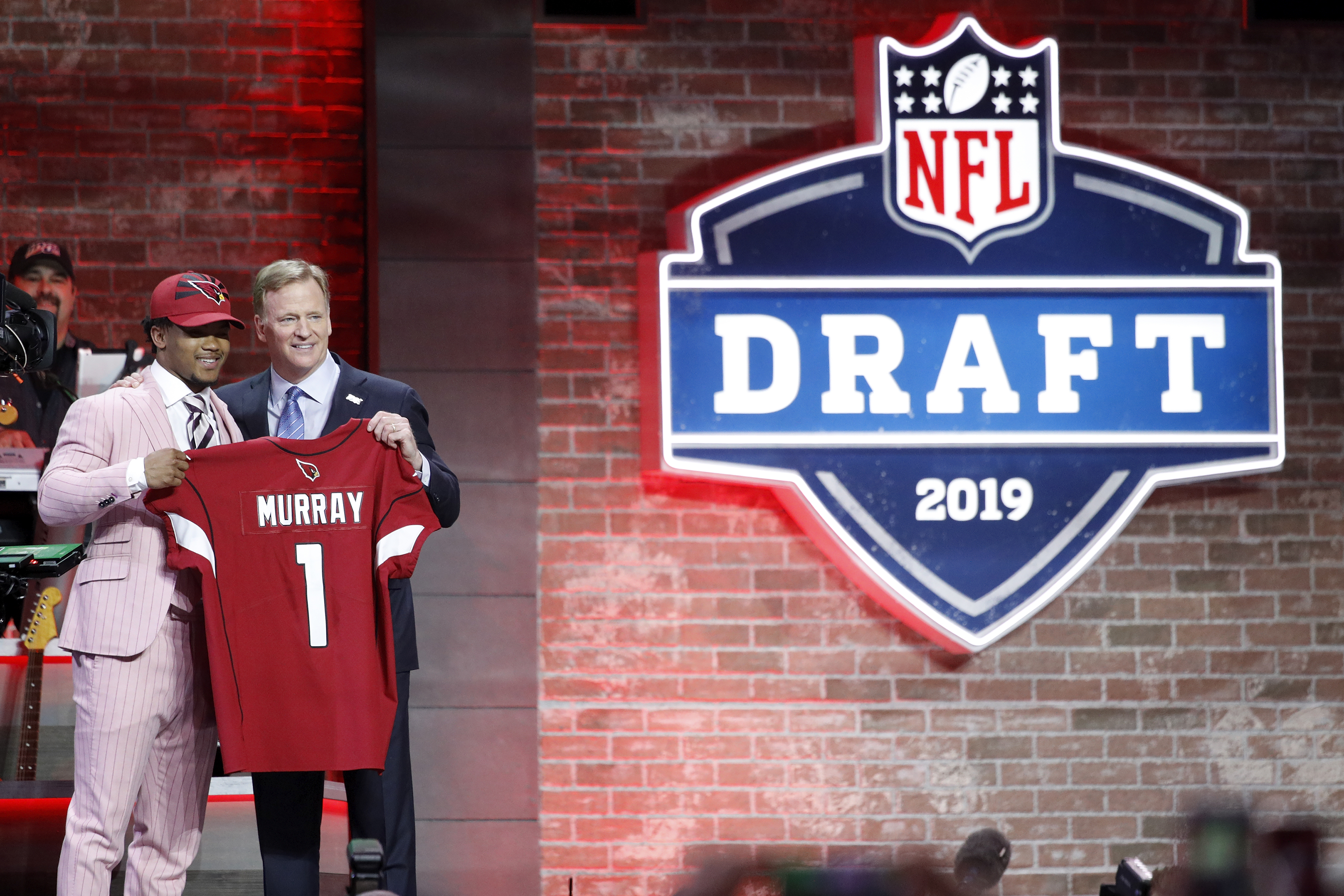 Former Oklahoma Sooners QB Kyler Murray poses with NFL Commissioner Roger Goodell after being drafted by the Arizona Cardinals with the first pick of the 2019 NFL Draft, Apr. 25, 2019.