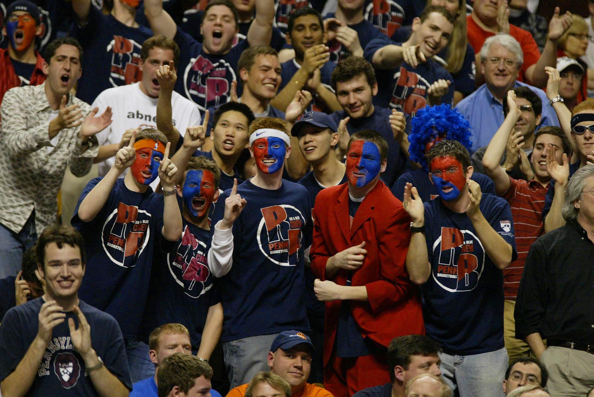 Fans cheer for their team