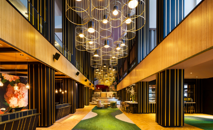 Lobby with pendant lights and green walkway.