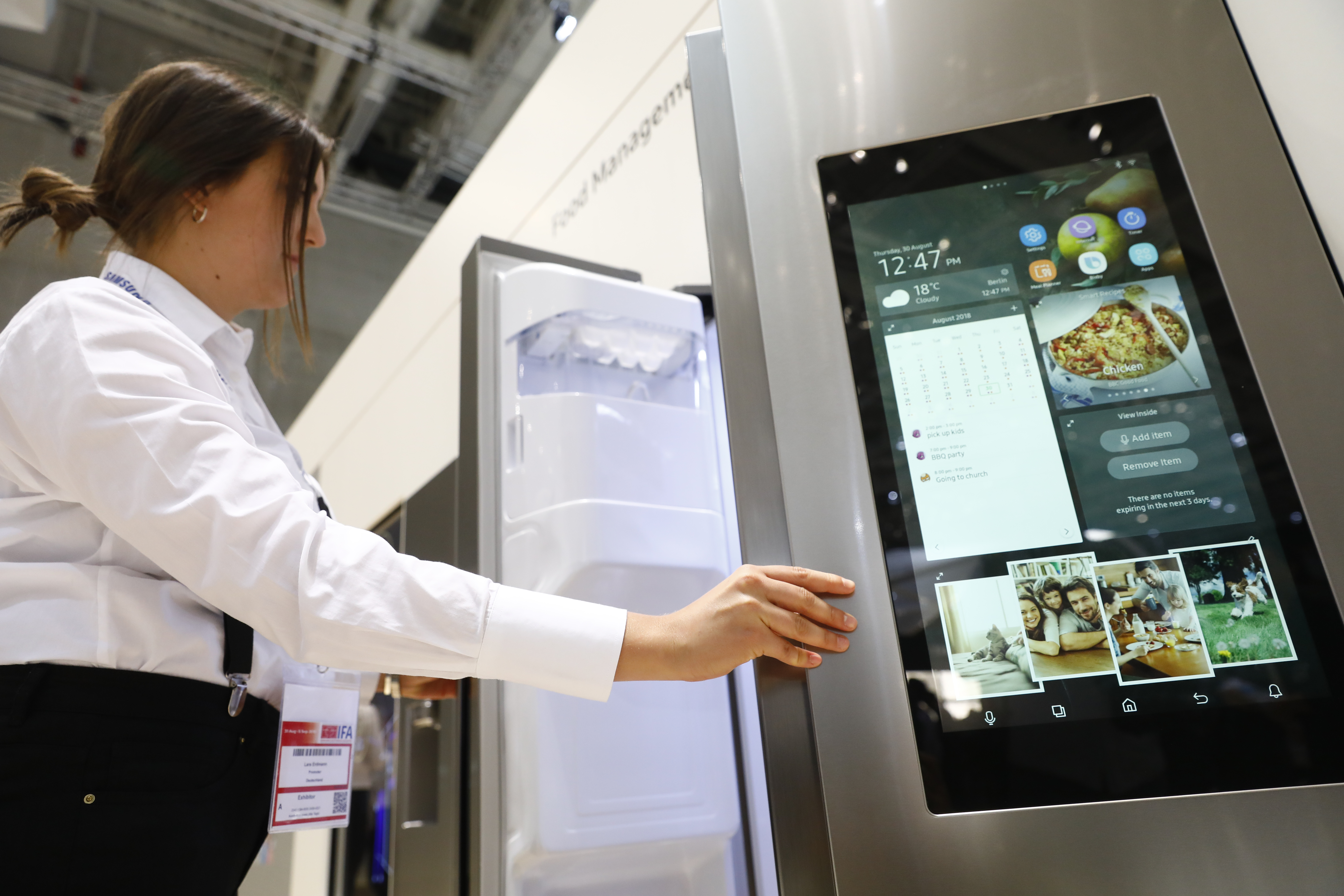 Visitors look at the Samsung Home appliance smart Fridge at the 2018 IFA consumer electronics and home appliances trade fair.