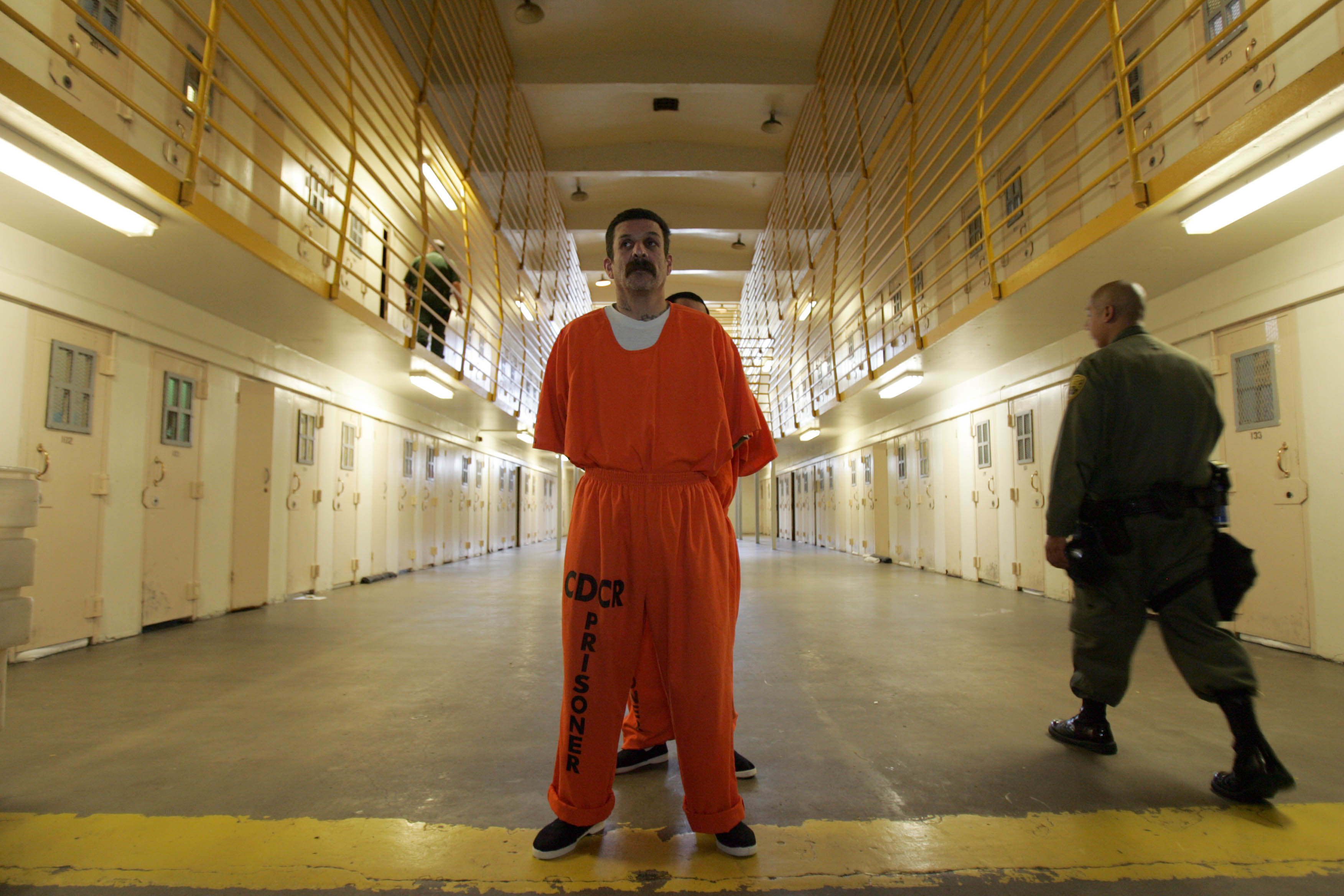 Inmates are lined up in Madrone Hall at the California Institution for Men in Chino, California, on May 24, 2011.