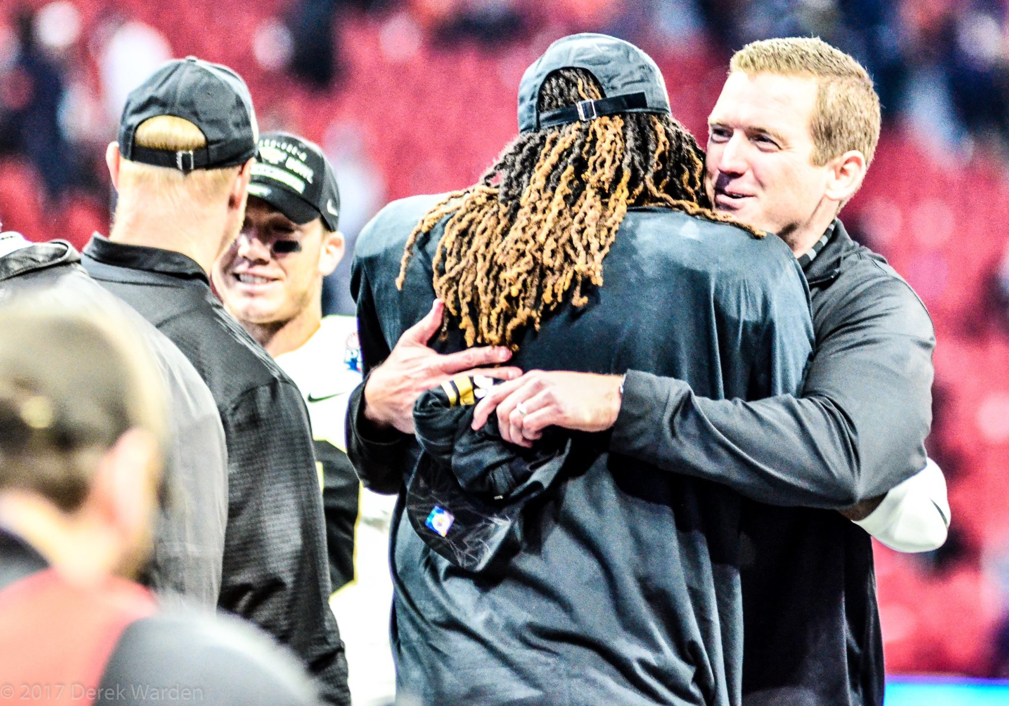 UCF A.D. Danny White embraces Shaquem Griffin after the Knights' victory over Auburn in the 2018 Chick-Fil-A Peach Bowl. (Photo: Derek Warden)