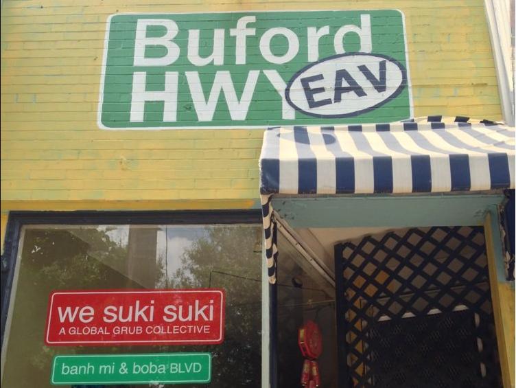 Signage for We Suki Suki and the Global Grub Collective.