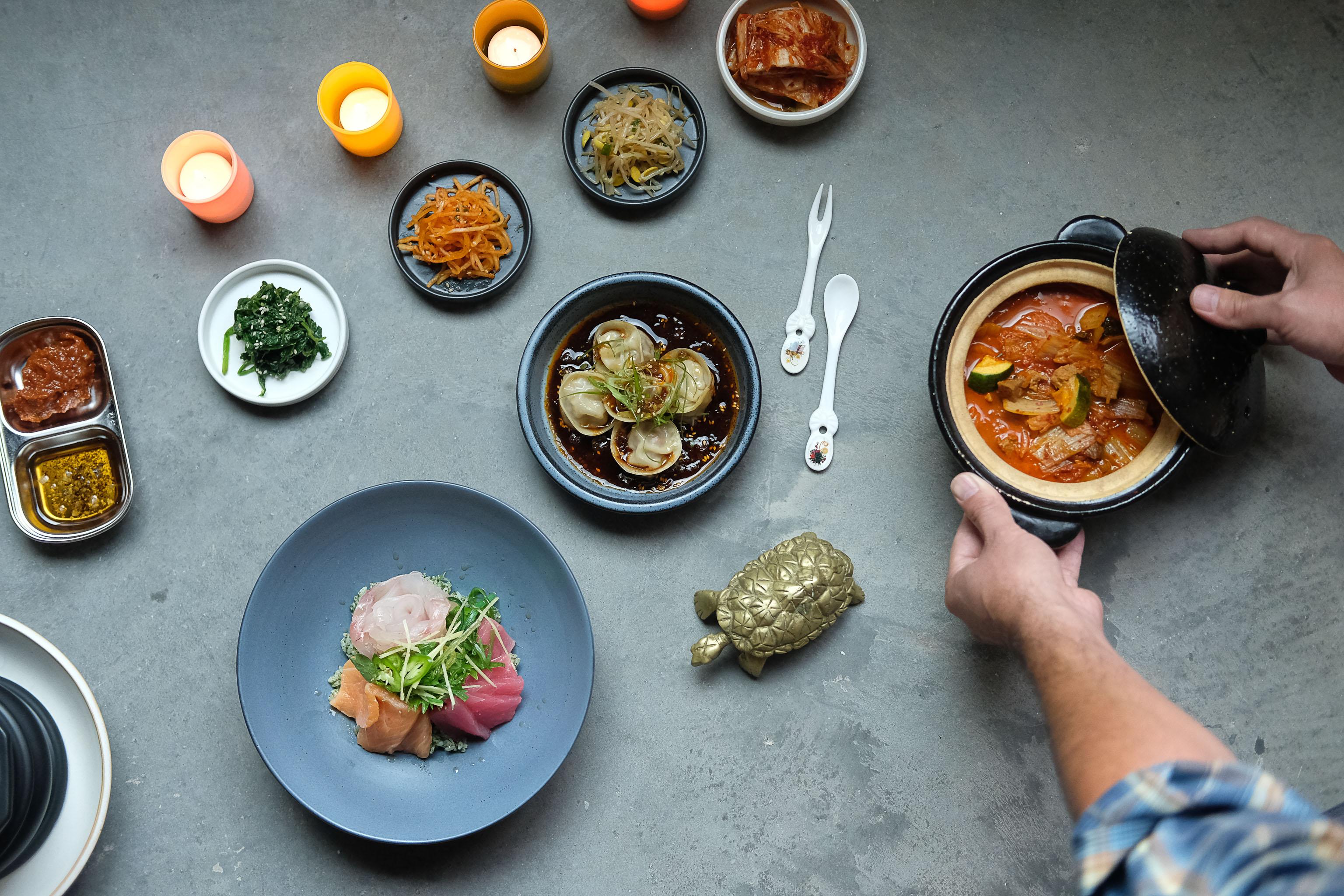 Oseyo's banchan, kimchi jigae, hwe dup bap, and mandu