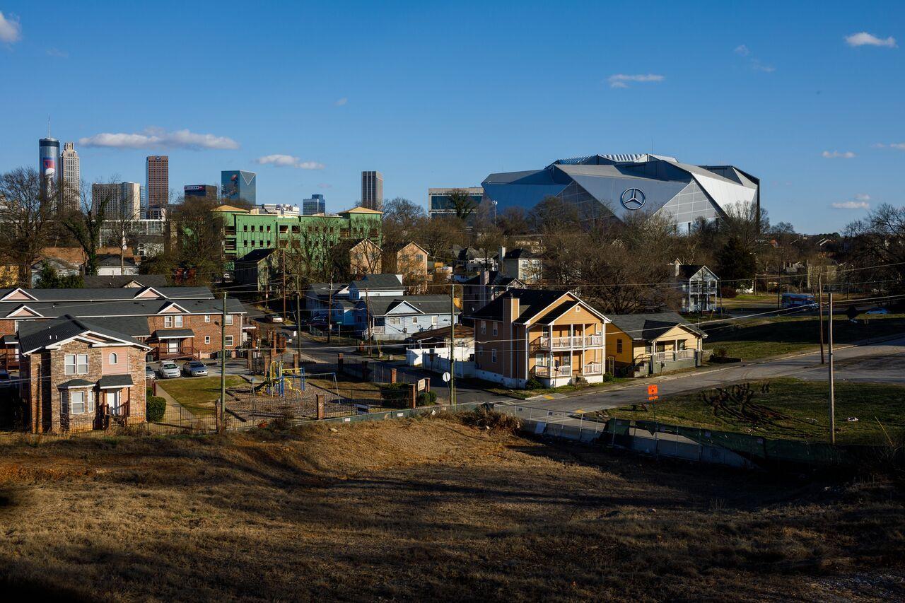Vine City, with symbols of Atlanta's downtown prosperity beyond.